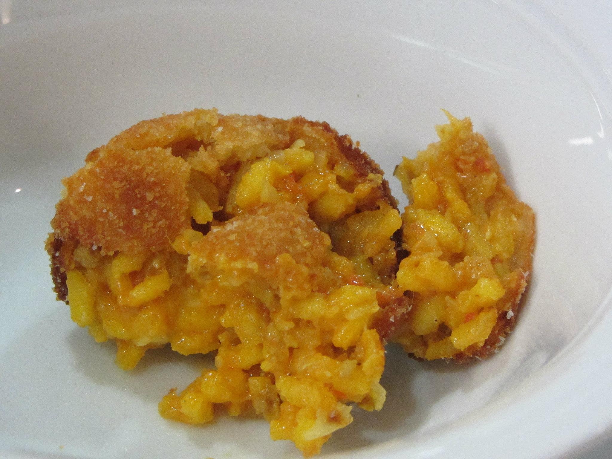 Arancino with saffron and mozzarella.