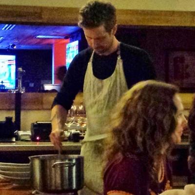 Chef Lachlan stirring the riso marinara