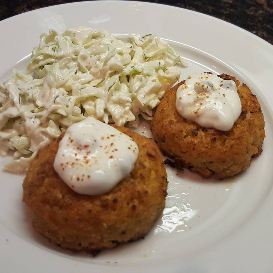 Crab cakes with dill slaw and caper-lemon-espelette yogurt sauce.