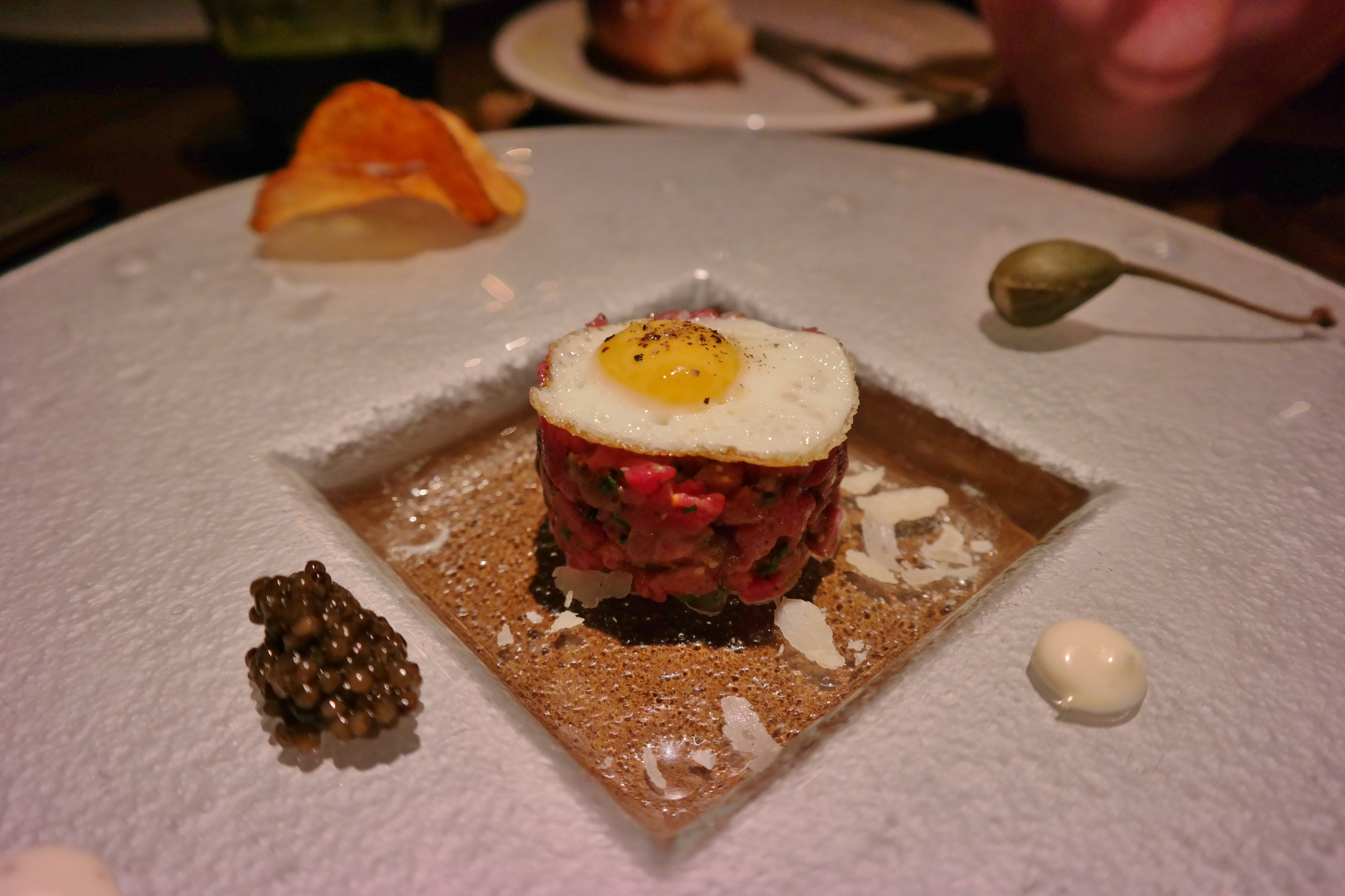 Tartare with quail egg, caviar, and caper berry