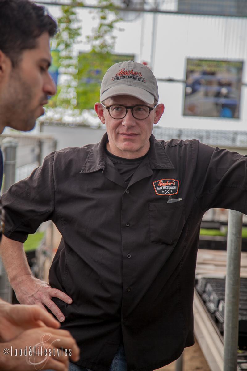 Chef Brian Luscher listening to Joseph Martinez