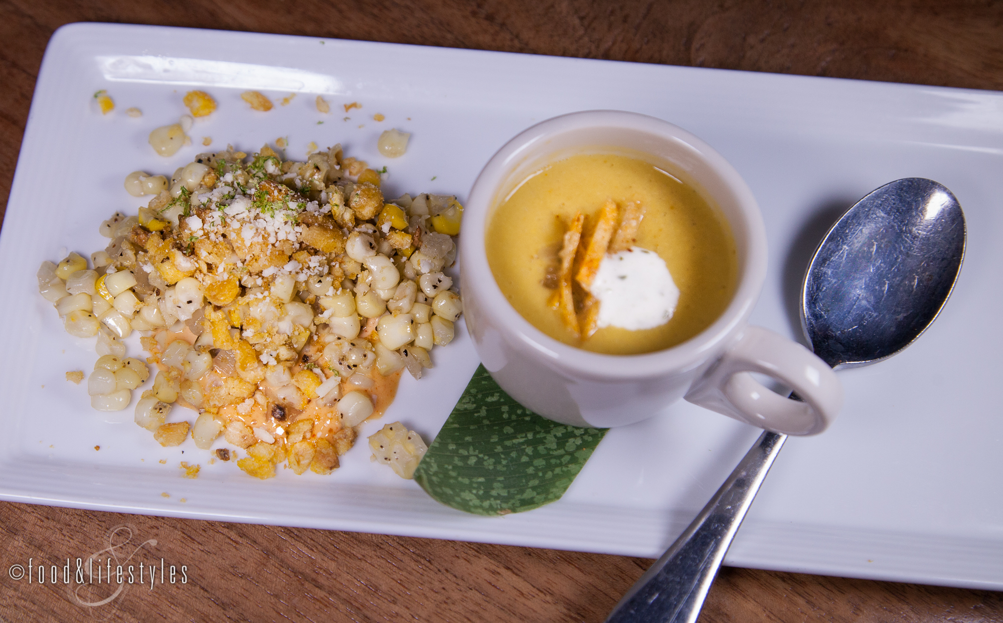 Roasted corn soup with cilantro crème and grilled corn with lime and cotija cheese