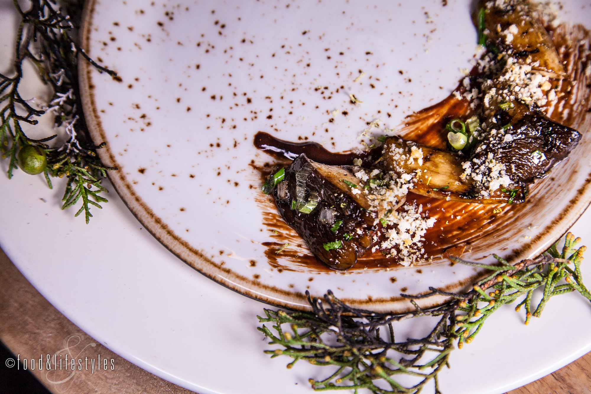 Wild mushrooms with smoked pine needles, pine nut gremolata, and Mexican chocolate