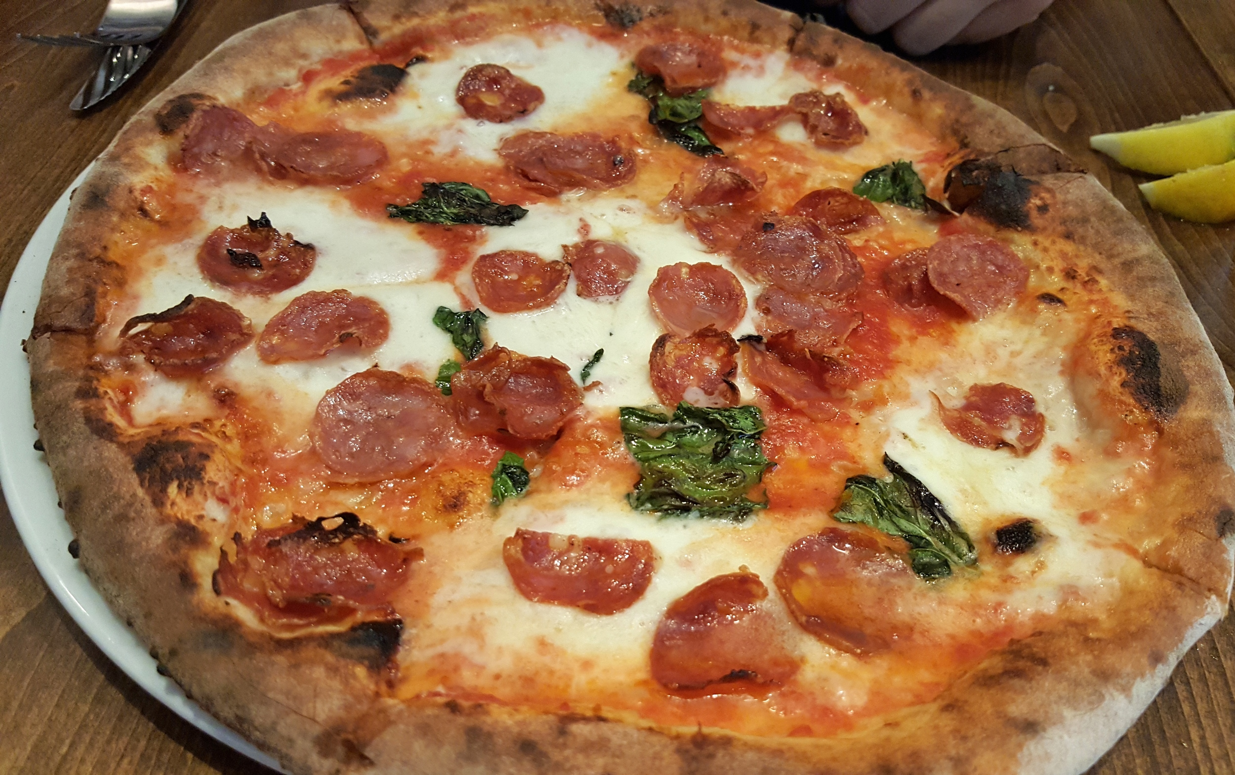 Diavola pizza with spicy salame and basil