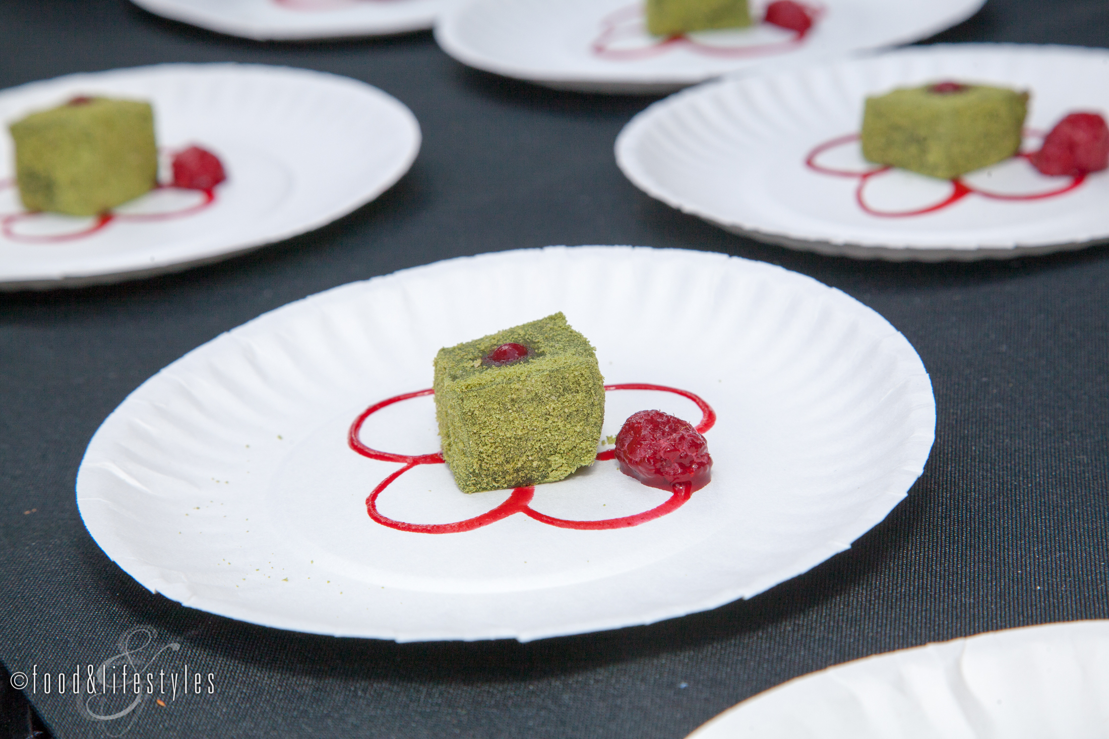 Hana's Matcha Mochi Warabi Mo Hi (pounded rice squares in matcha powder with raspberry)
