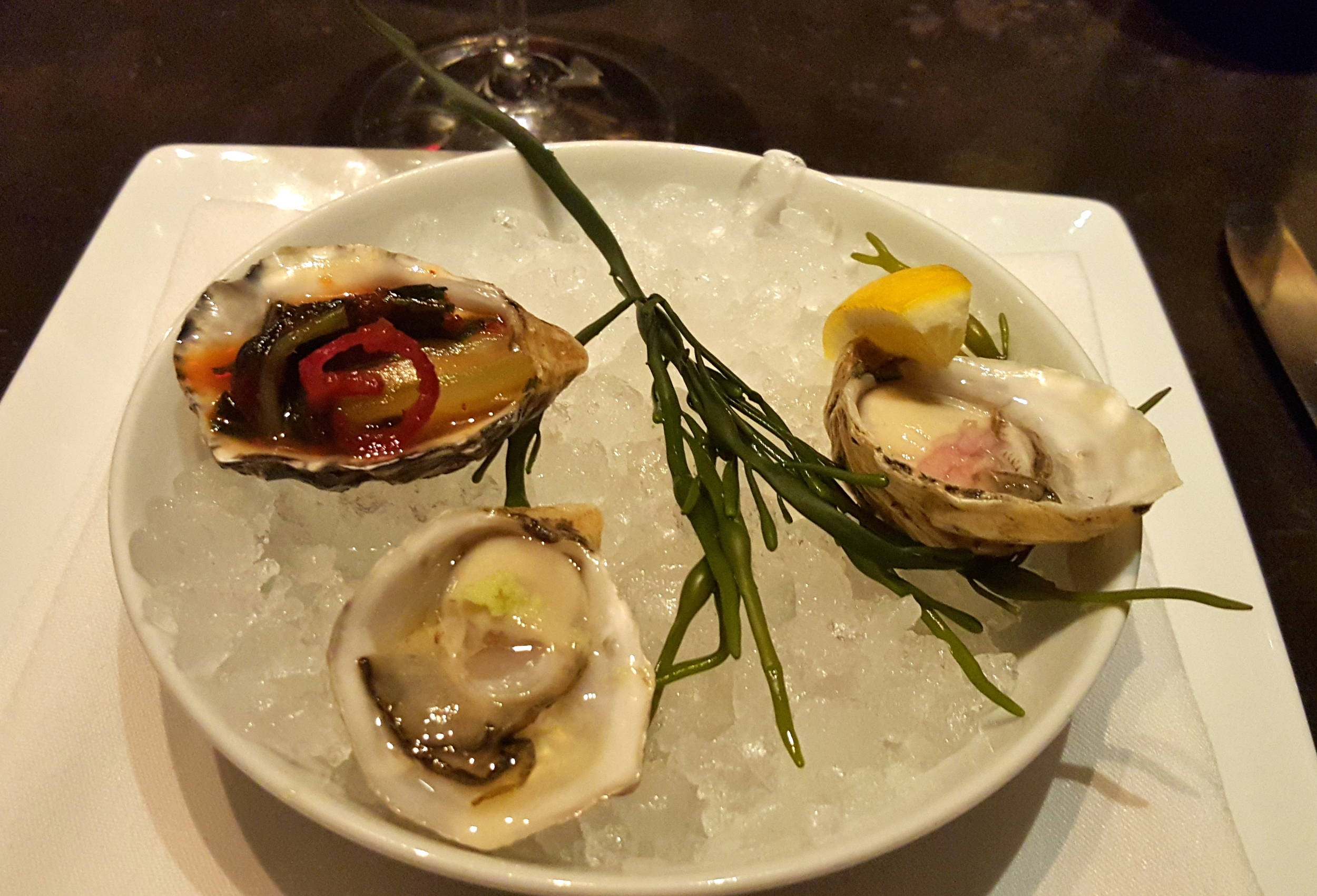 Oyster trio with kimchi, mignonette, and ponzu with wasabi