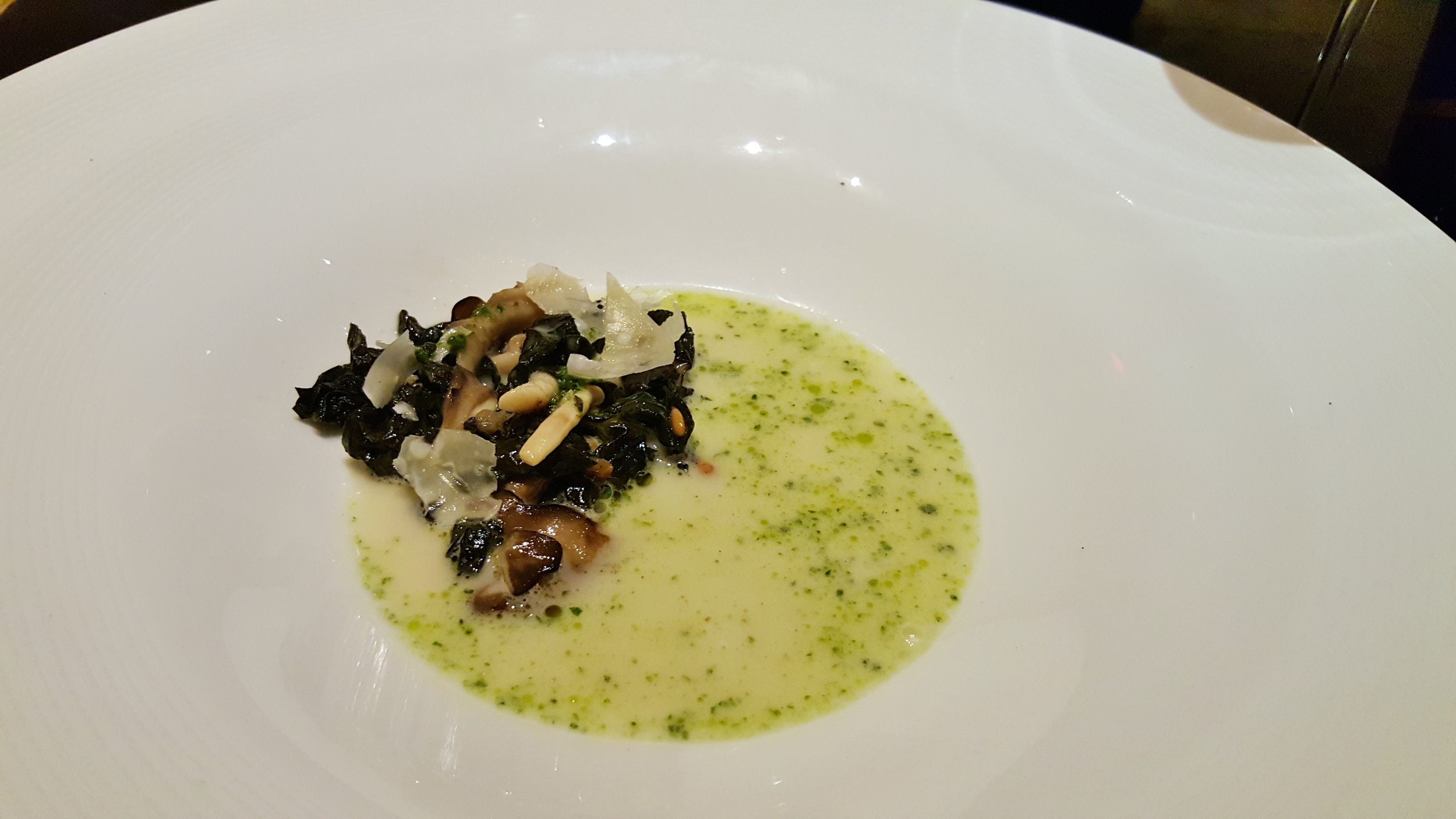 Miso-parmesan broth with kale-basil pesto and wild mushrooms