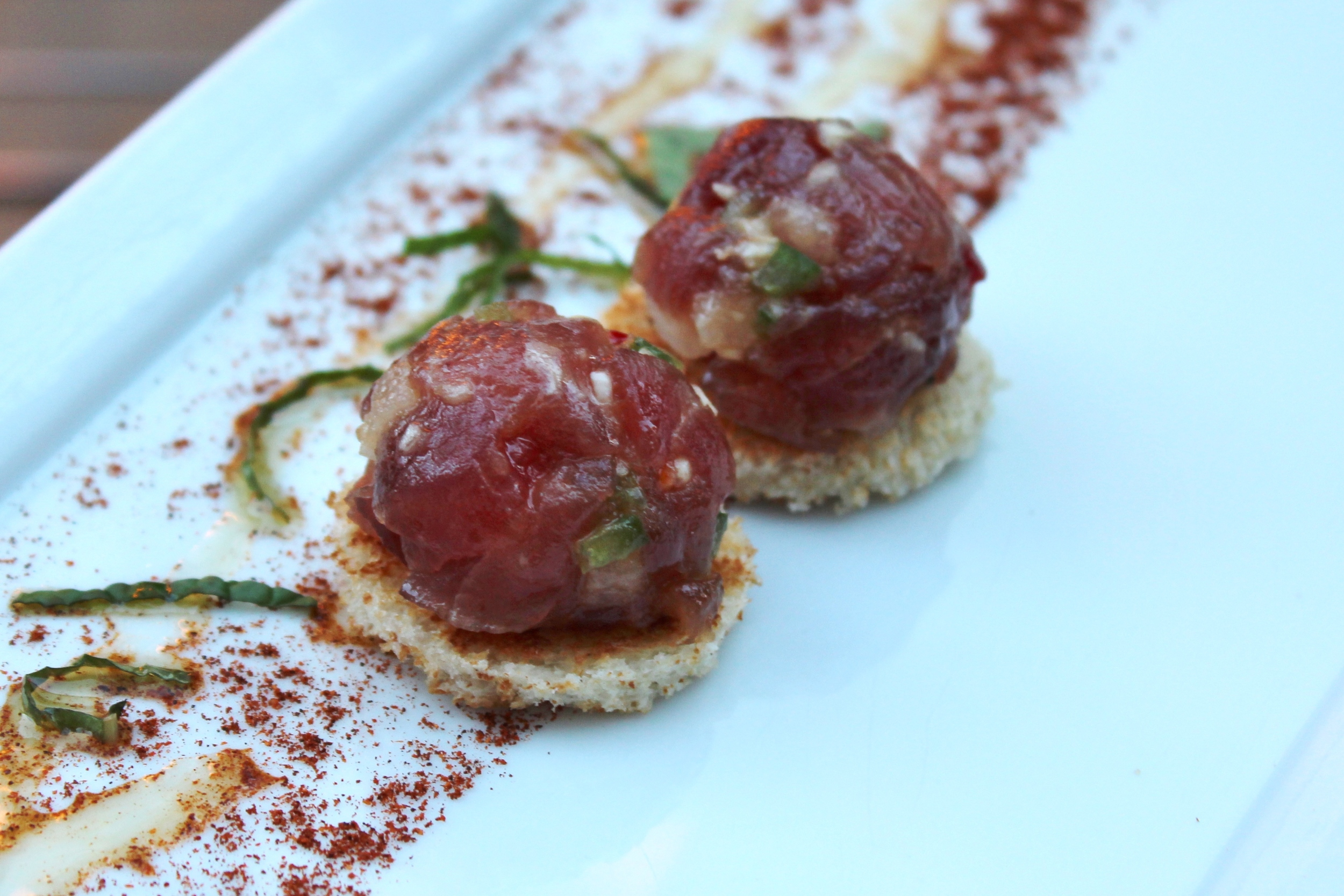 Tuna tartare with ancho chile, Asian pear, pine nuts, and mint