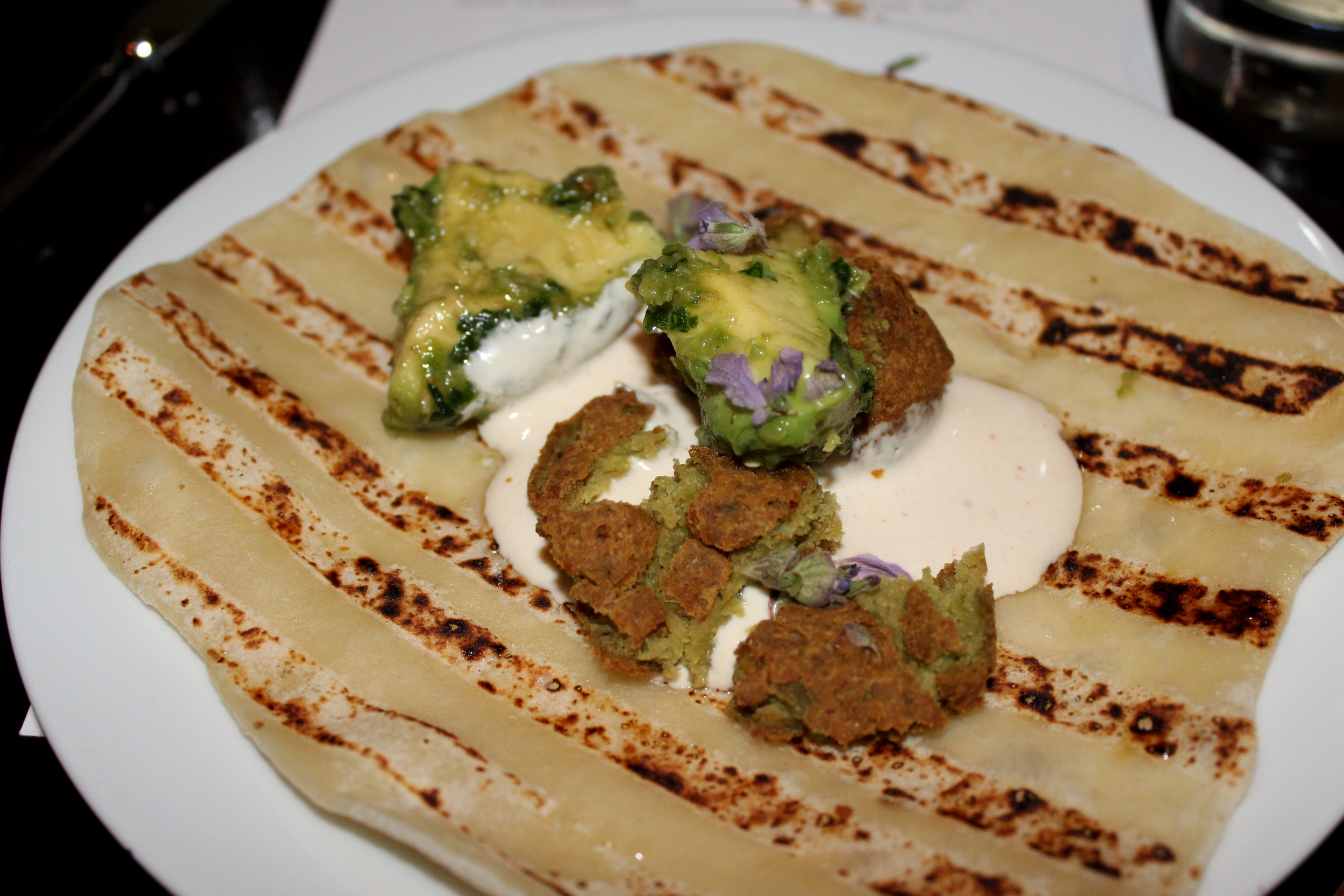 Fava bean falafel with labneh, avocado, and spicy Yemenite schug