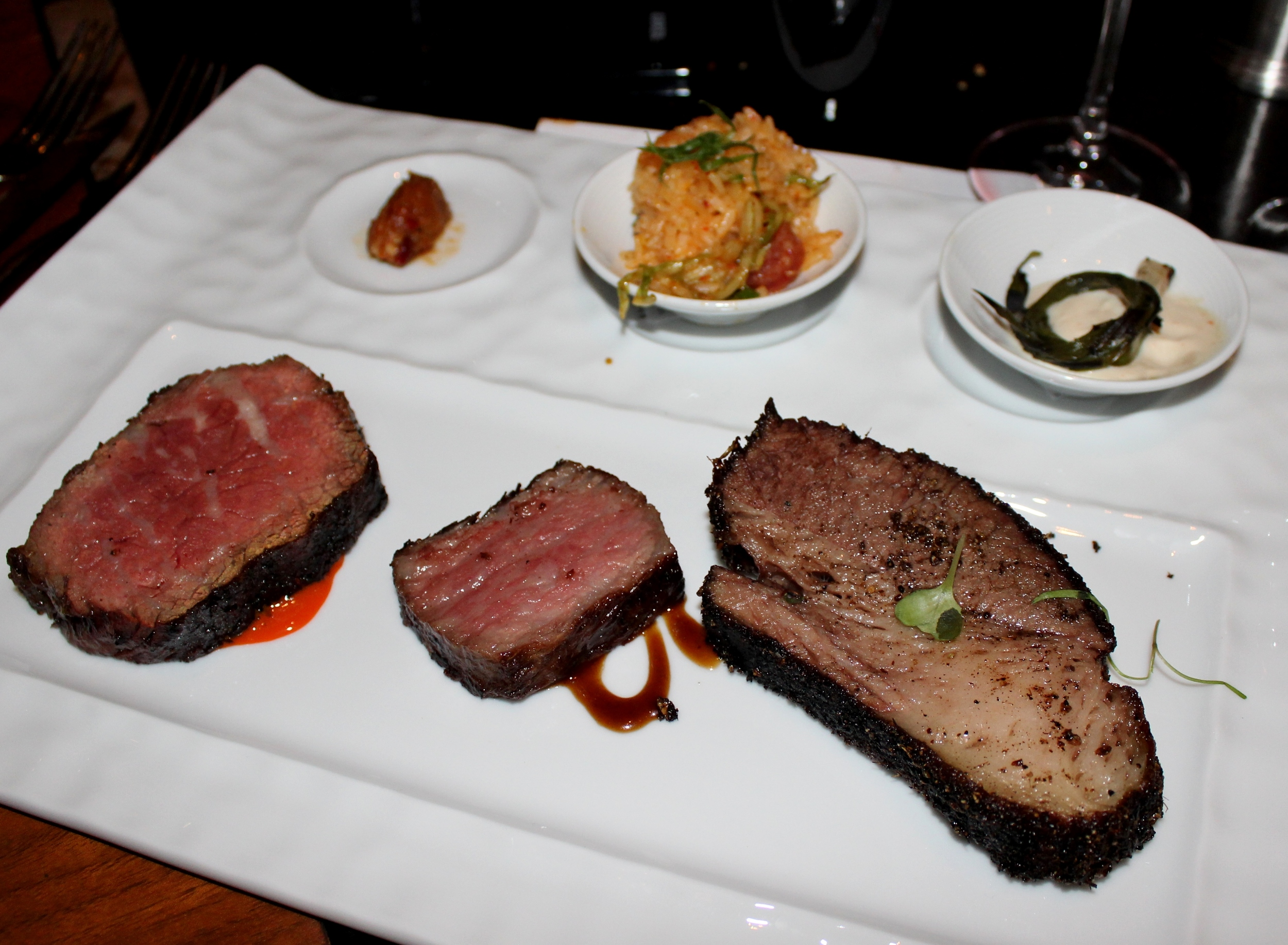 Dry-aged beef, A5 wagyu and Yemenite spiced brisket. Accompaniments: Calabrian chile XO sauce, foie gras fried rice, scallion cream