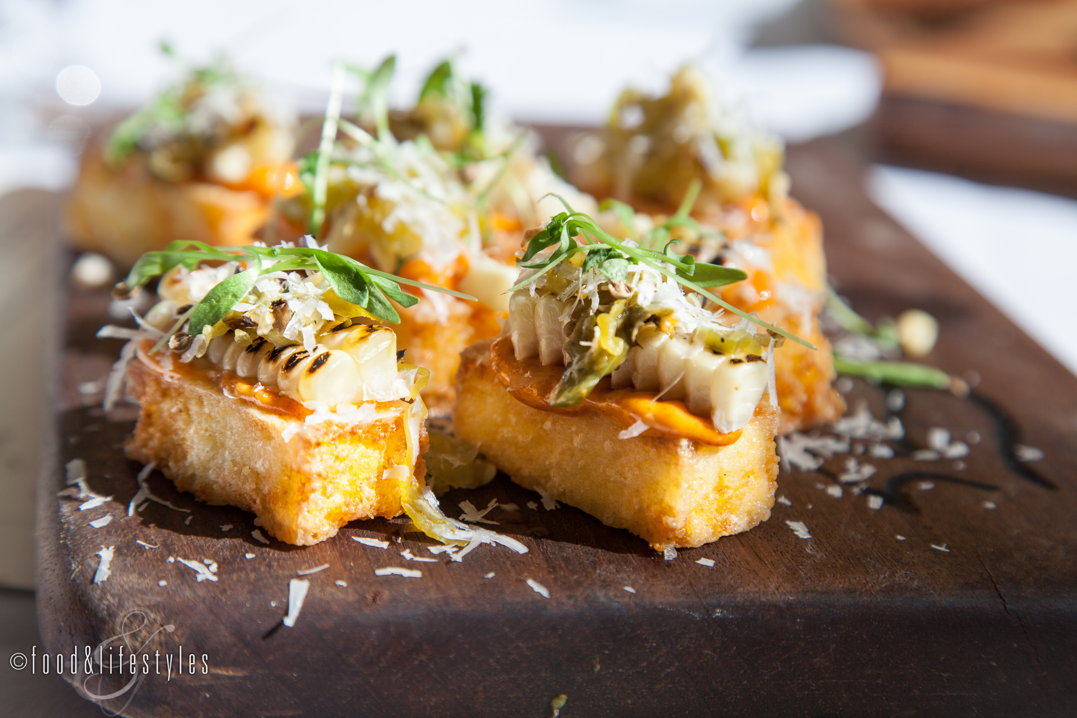 Polenta squares with shishito peppers and grilled corn