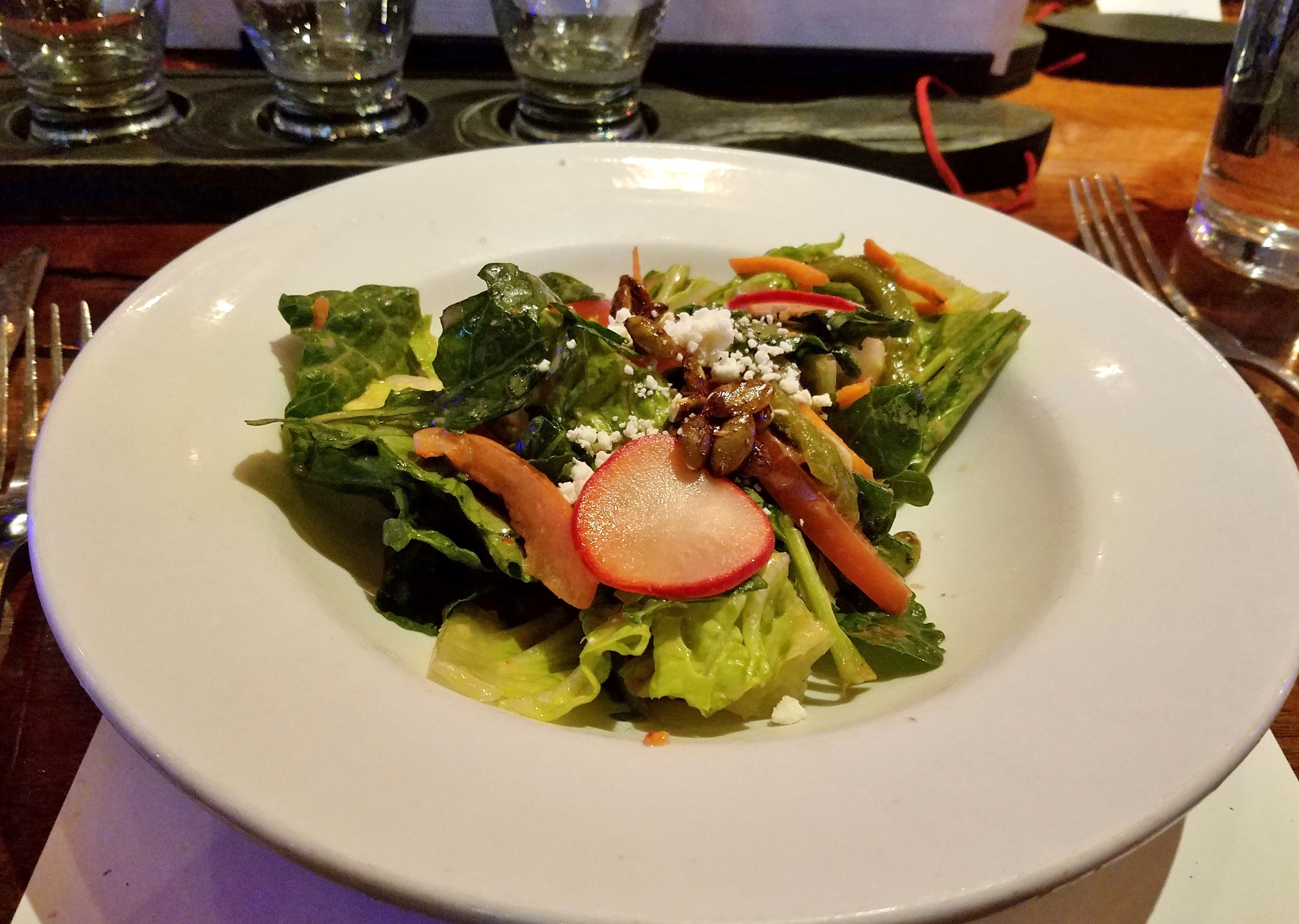Salad with spicy pumpkin seed brittle, queso fresco, pickled radishes, and blood orange vinaigrette
