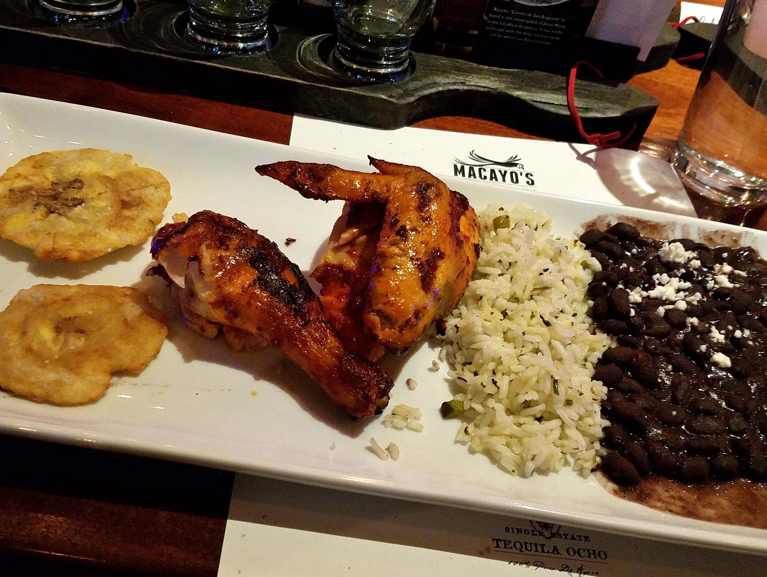 Pollo asado with platanos, cilantro rice, and black beans