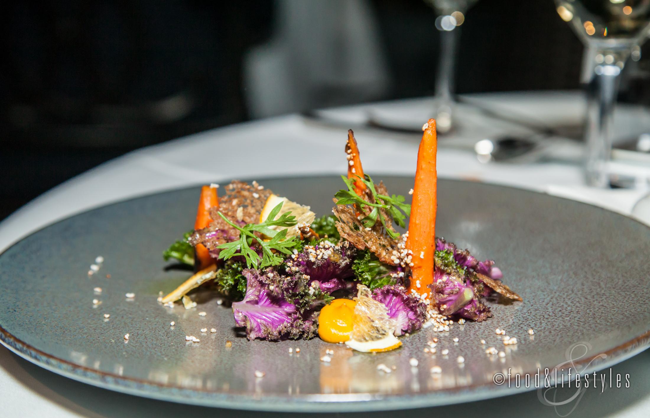 Kale salad with carrots, robiola, amaranth and orange blossom vinaigrette