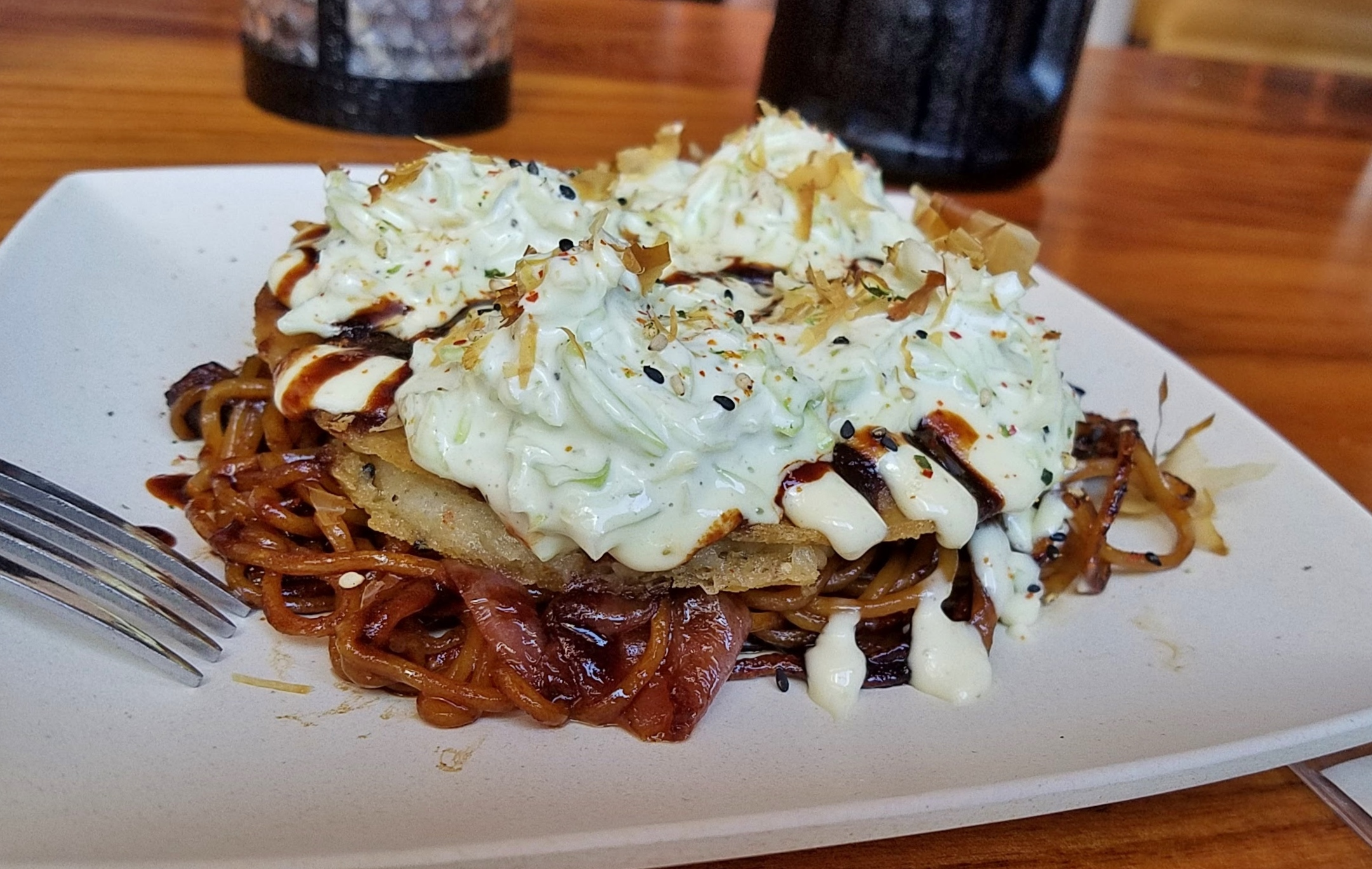 Okonomiyaki with Yum Yum Noodles, pork belly, jalapeño mayo, wasabi slaw