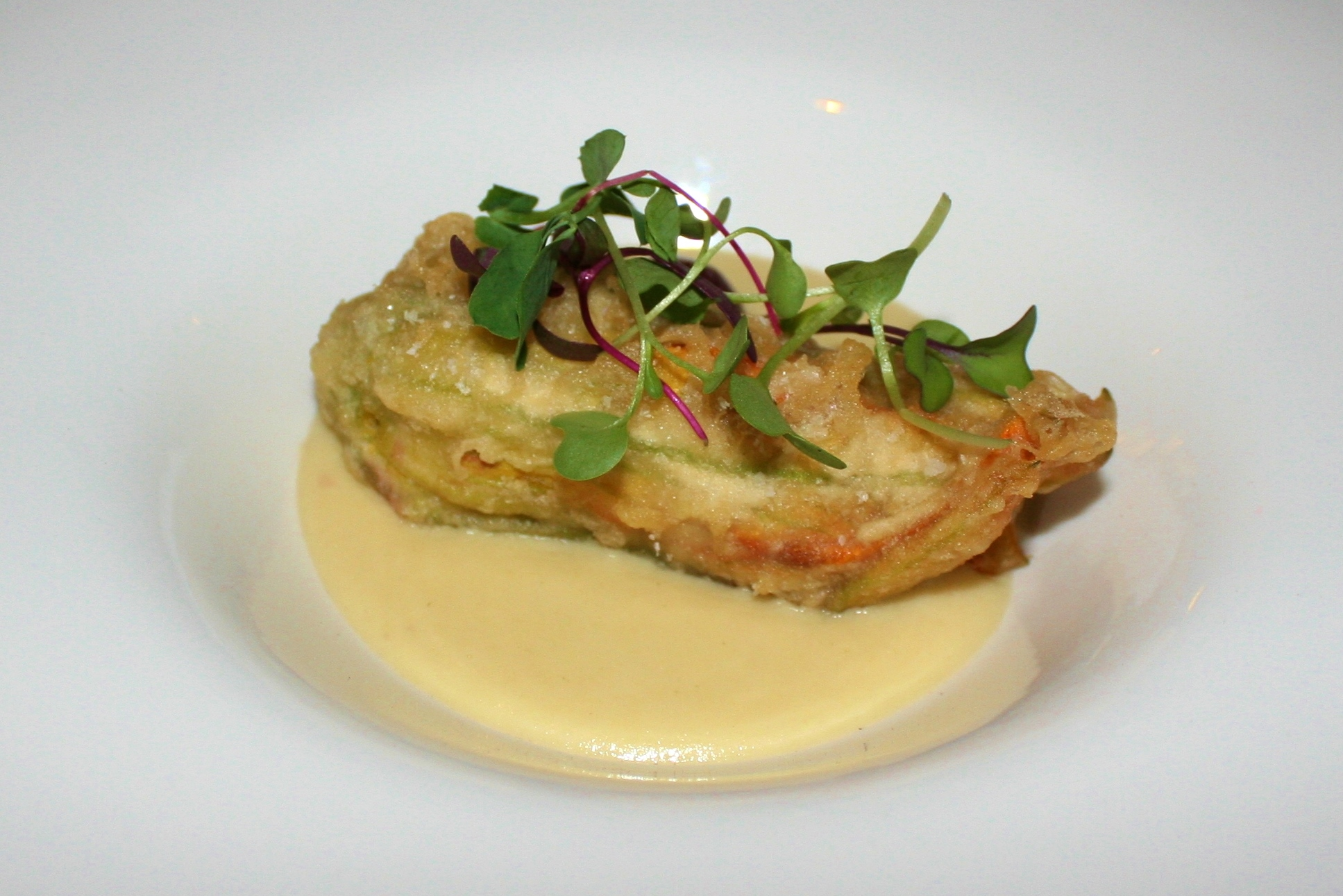 Squash blossom stuffed with mesquite-smoked lobster on roasted corn puree at Sel in Scottsdale
