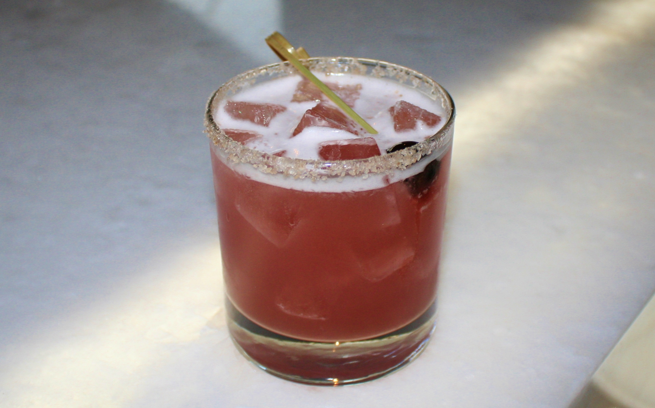 Cerise Fumée with Vida mezcal, Ancho Reyes chile liqueur, black cherry puree, lime juice and smoked sea salt.