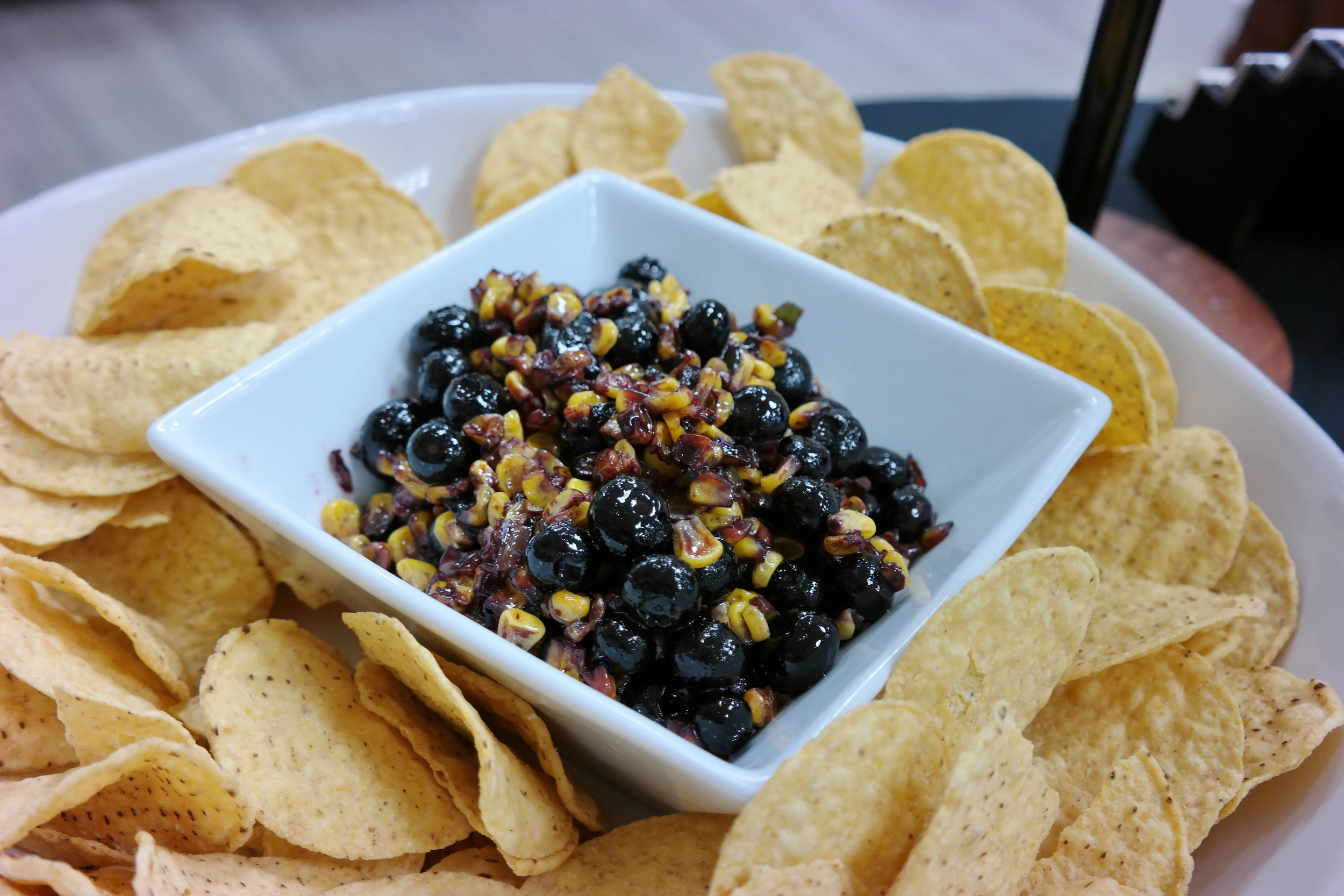 Blueberry-corn salsa with VomFASS basil olive oil, blueberry balsamic, and jalapeno oil