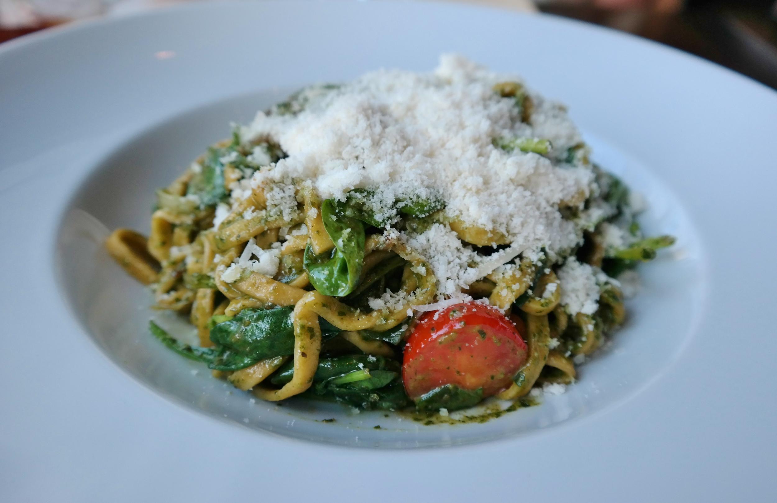 Handmade pasta with pesto and tomatoes