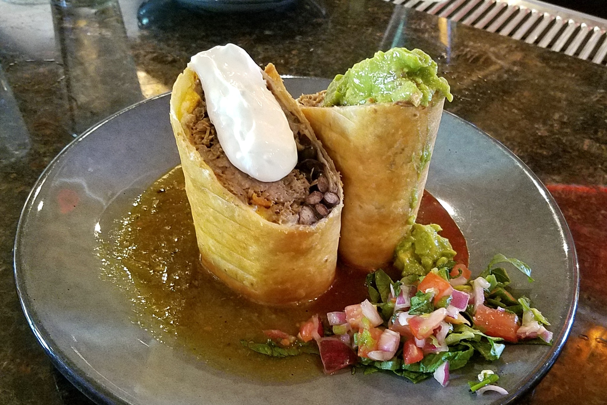 Barbacoa chimichanga with green and red chili