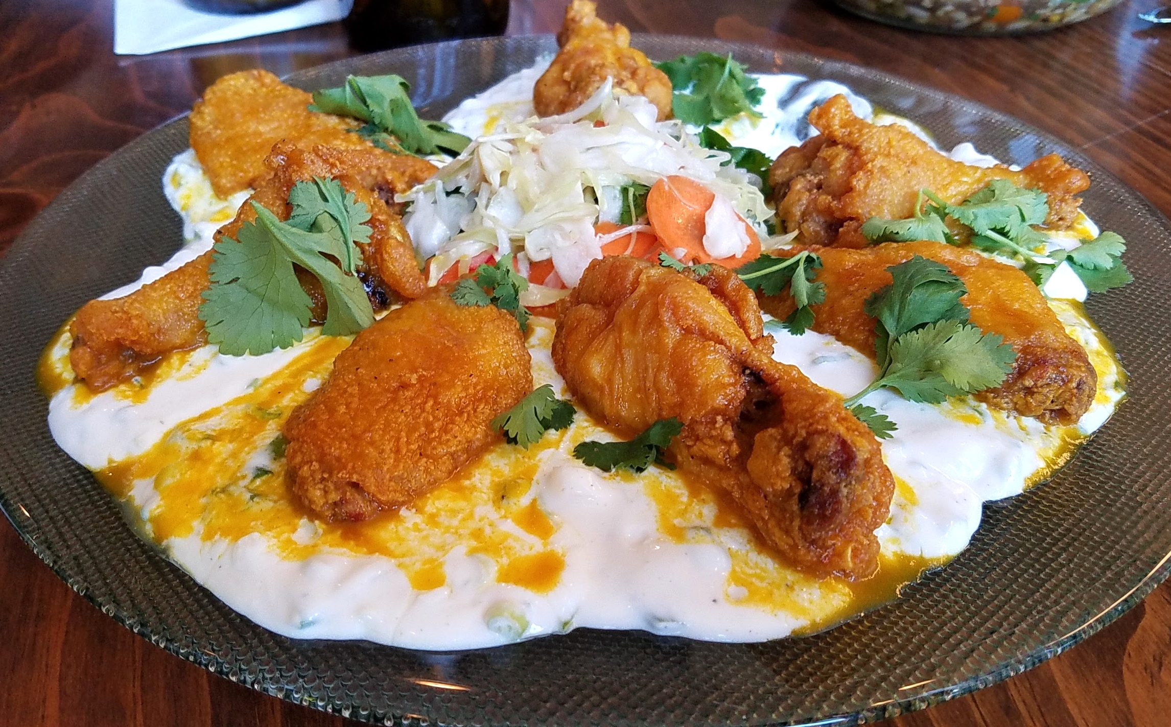 Crispy chicken wings with honey-aji amarillo sauce, Crow's Dairy   quark with scallions, and slaw