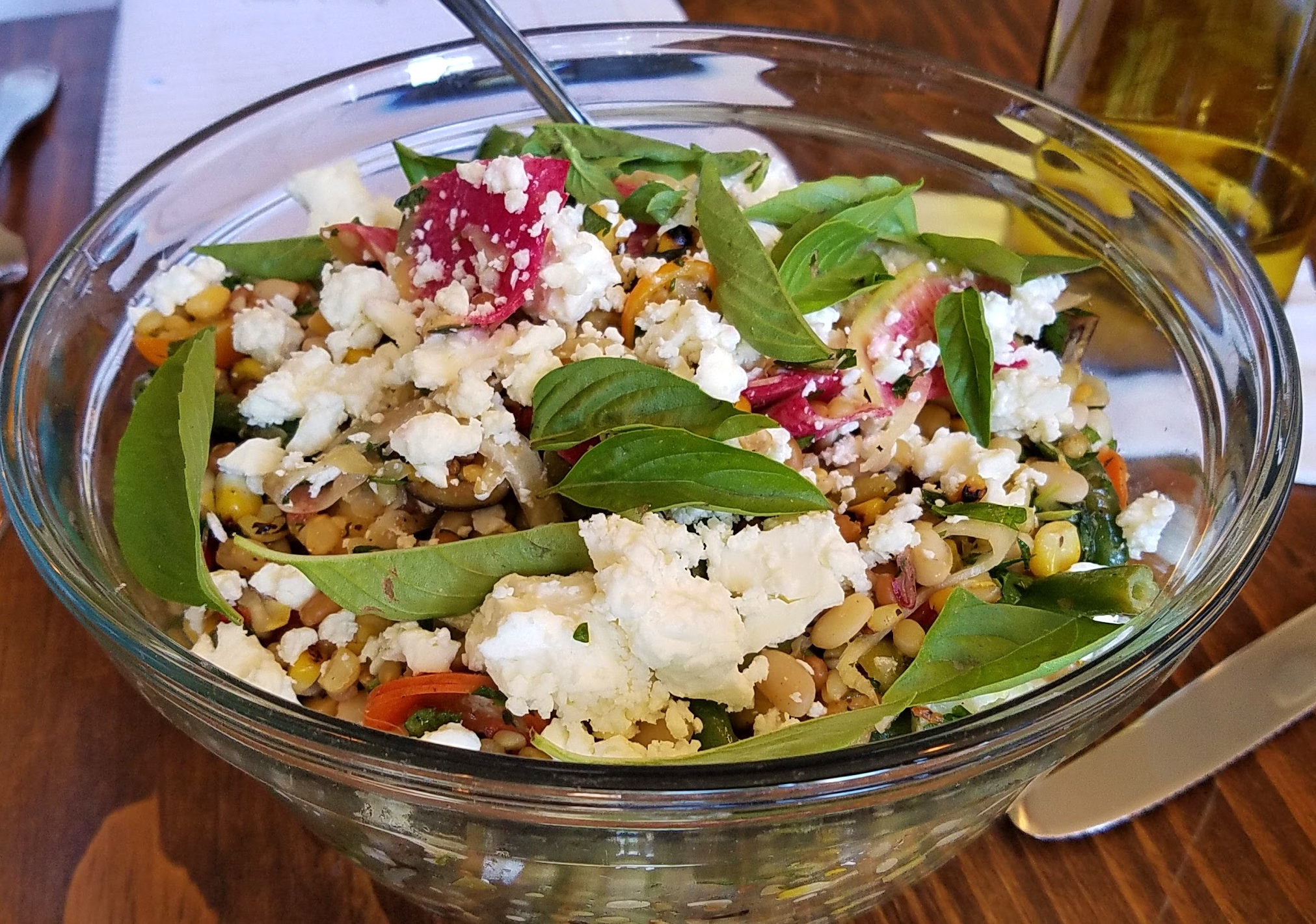 Hayden Flour Mills grain salad with tepary beans, radishes, basil, and goat cheese.