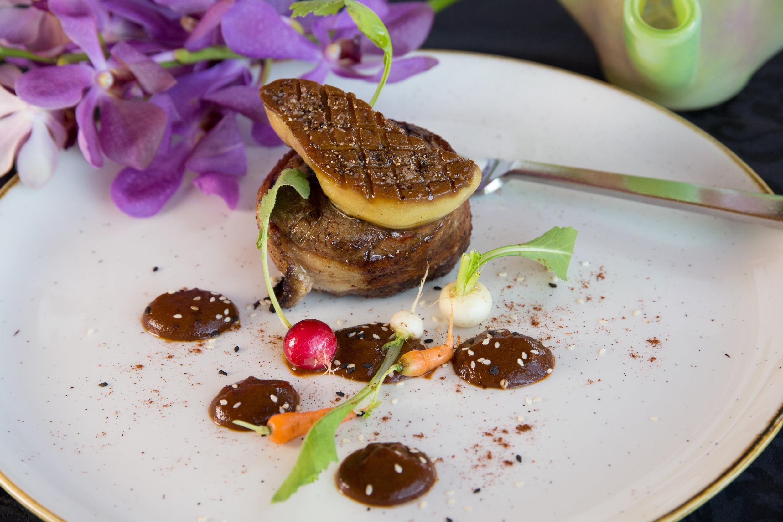 Bacon-wrapped buffalo tenderloin with foie gras and mole Oaxaqueño