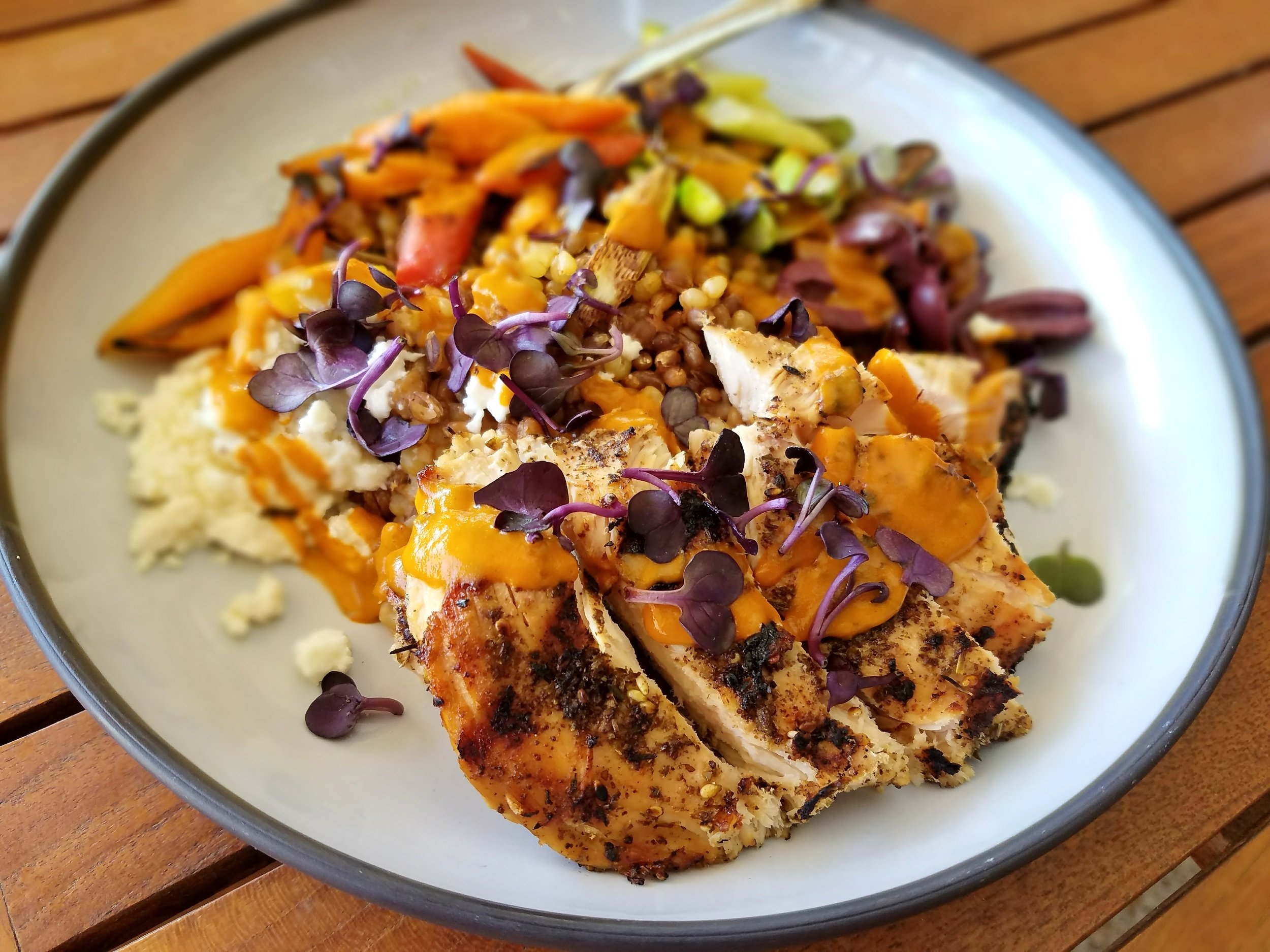 Za'atar chicken with farro, barley, feta, carrots, and asparagus
