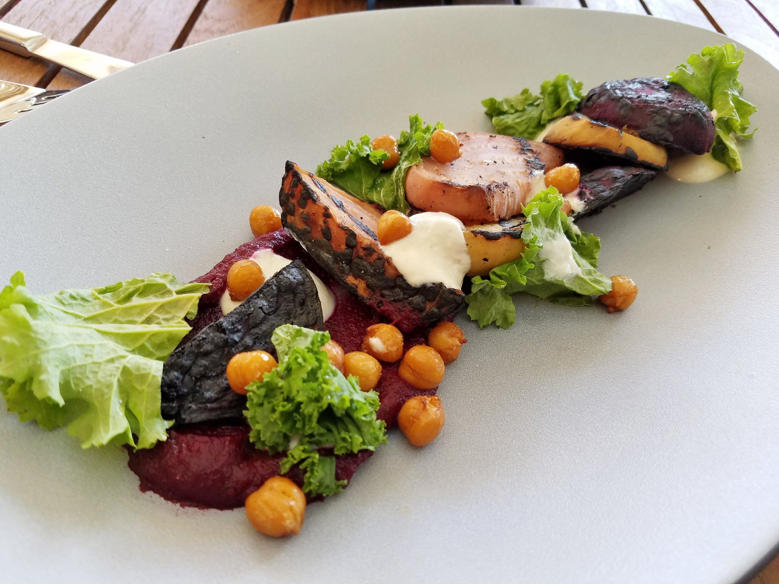 BBQ beets with mustard greens, chickpeas, smoked onion yogurt