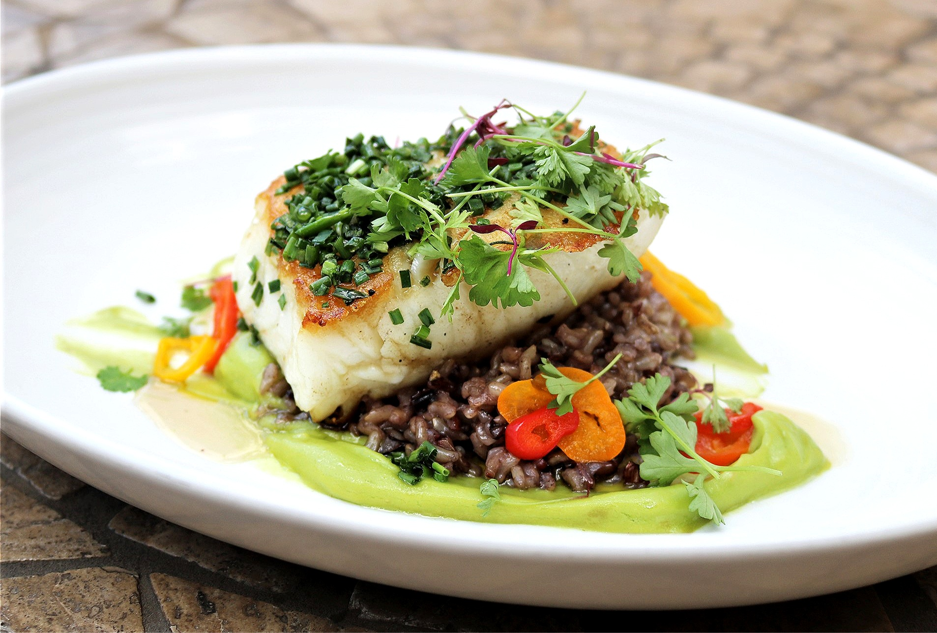 Sea Bass with Ancient Grain Risotto, Avocado Puree, Pickled Fresno Chili Citrus-Honey Reduction