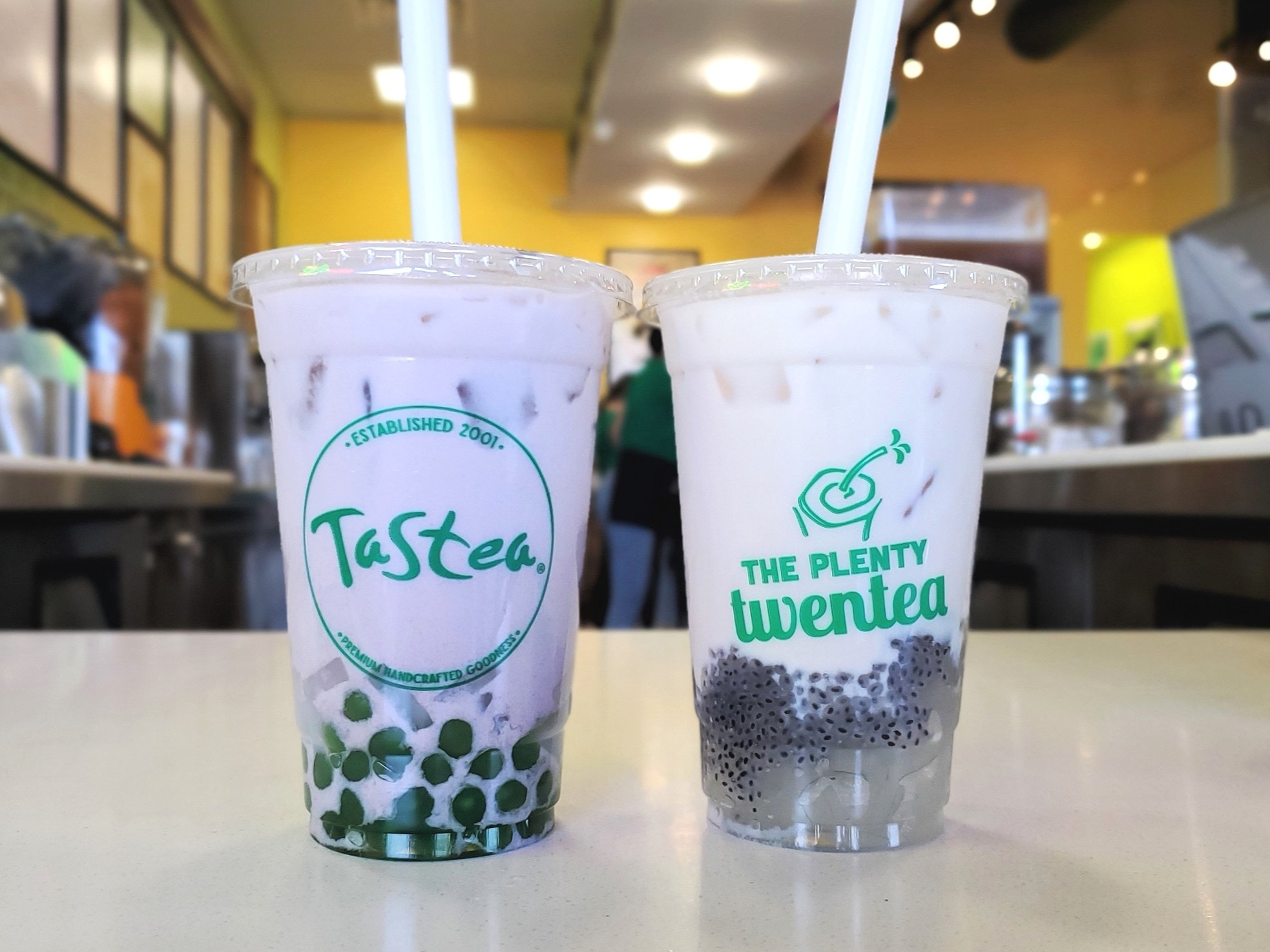 Taro milk tea with boba and lychee jelly for me, almond milk tea with aloe vera and basil seeds for mom.