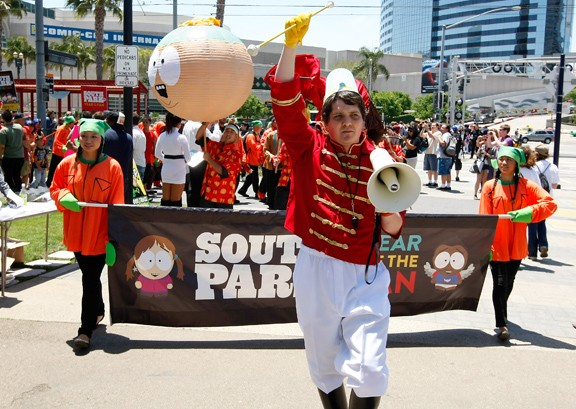 """From ComicAlliance.com's coverage of the event (http://comicsalliance.com/south-park-experience-comic-con/). I was doing a sort of call and response thing with the megaphone, yelling """"Come on down to South Park and have yourself a time / Come on down to South Park and meet some friends of mine"""". The light is a bit weird in this picture, but my hat was Cartman blue... it was applying the Cartman color patterning to a bandleader costume."""