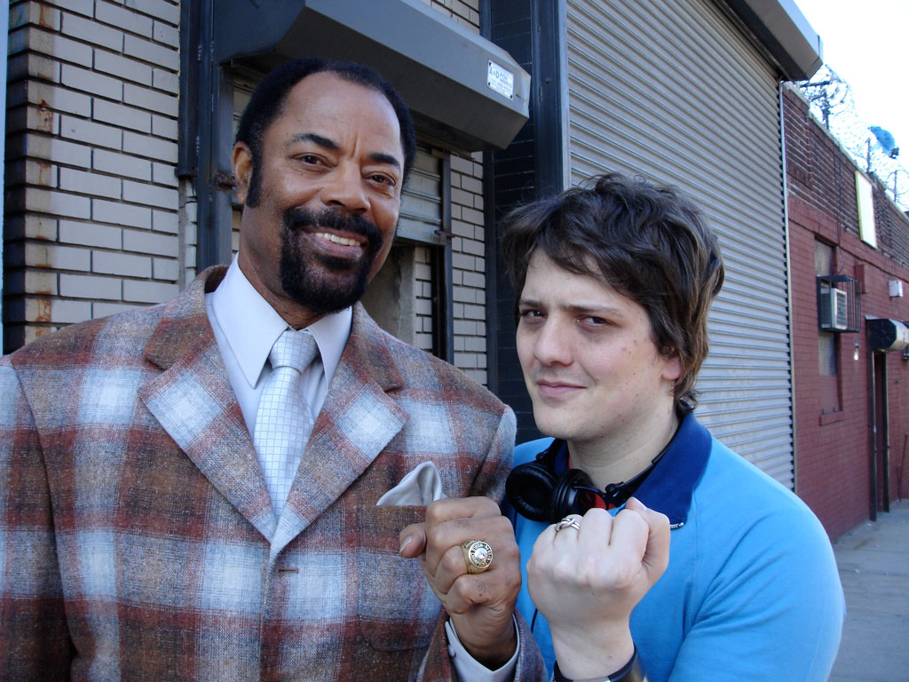 """Greatest Knick ever Walt """"Clyde"""" Frazier and I show off our rings (his championship, my wedding) on the set of C0NTR0L FR3AKS, 2006."""