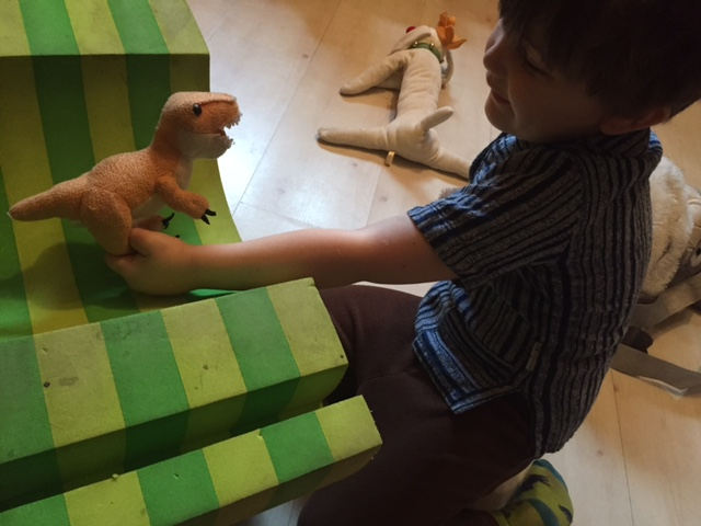 Lyric puts Baby Dinosaur in time out.