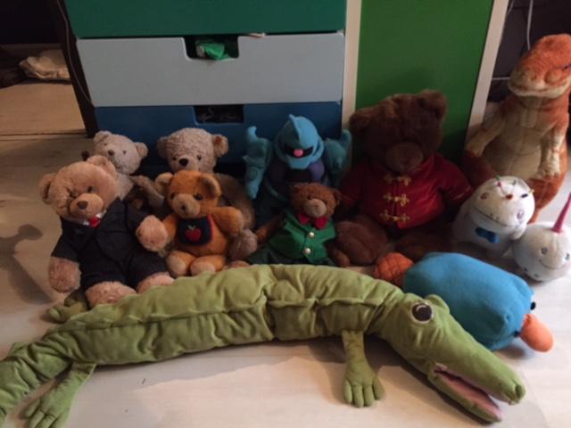 "Today's class, Back L to R: Arc, Arctos, Blue robot, Tyrone, Boris. Middle L to R: Fluffington Q. Ursine (""Fluffy""), Robear, Kuma, Perry, Chickens, Ragomorph. Front row: Crocodilus."