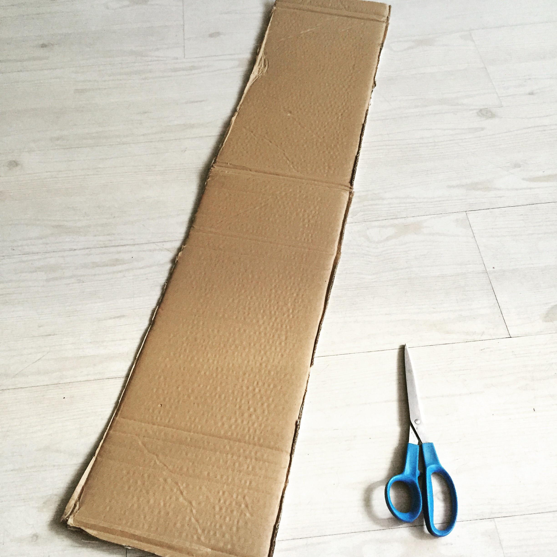 Step 2) trim cardboard to long strip