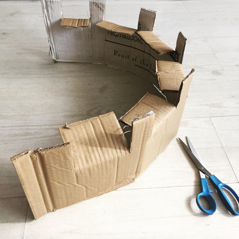 Step 4) Fold along the grain of the cardboard to create castle shape
