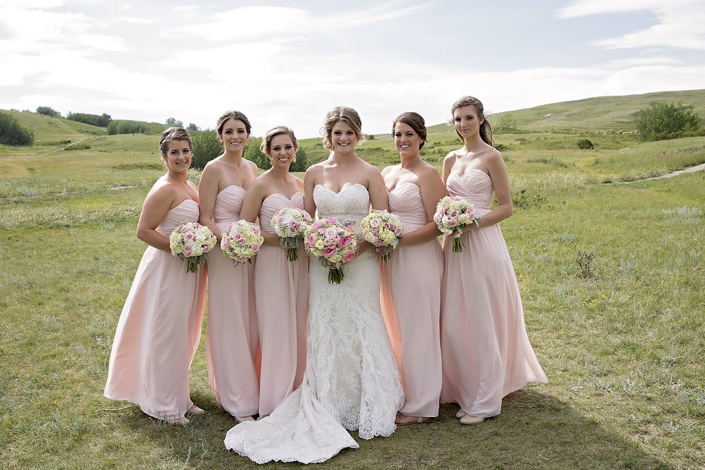 Bridal party with wedding bouquets