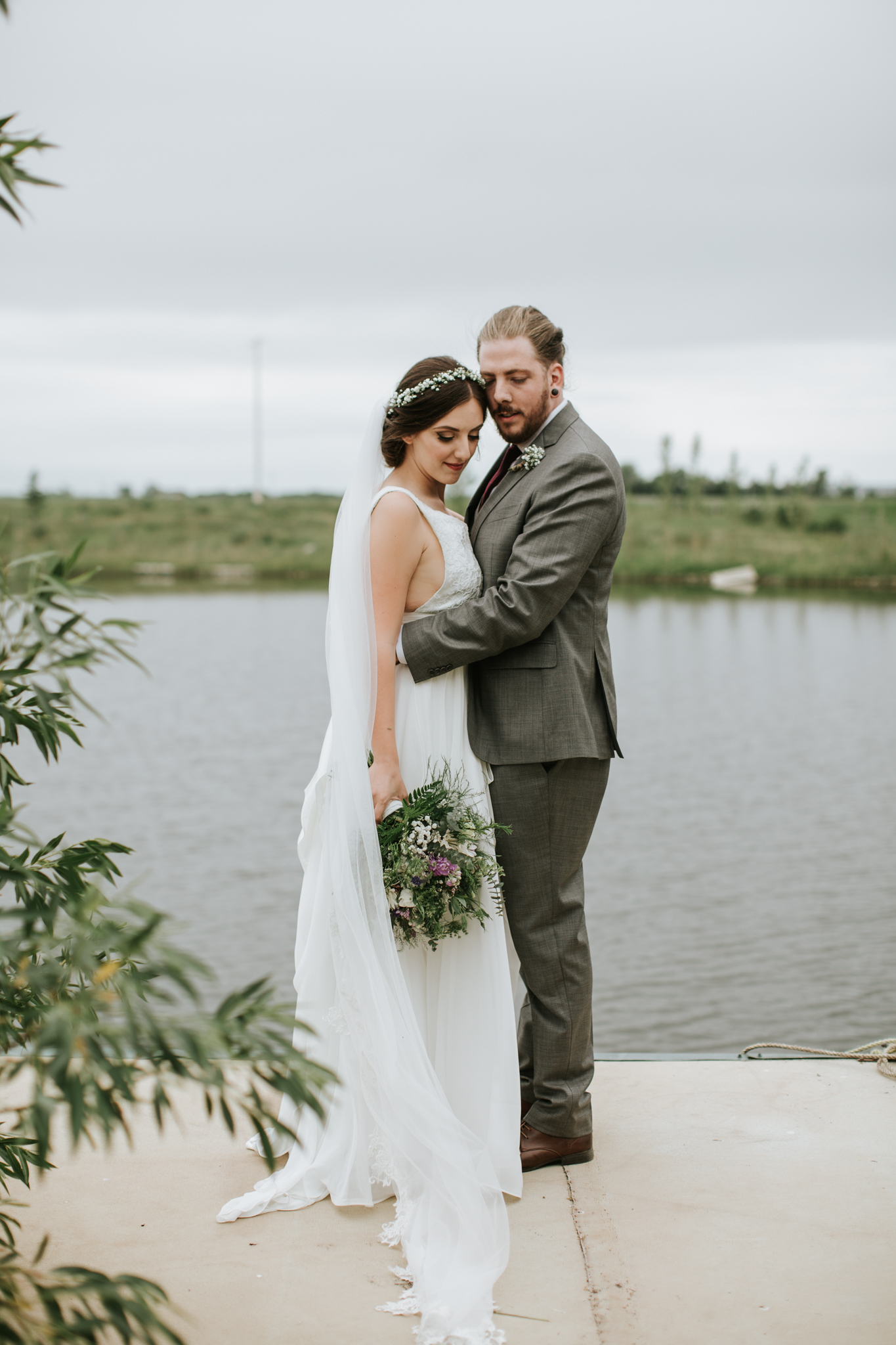 Bride and Groom with bouquet and boutonnières