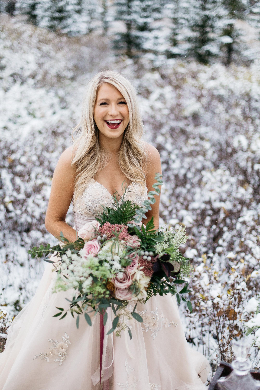 bride with elegant wedding bouquet