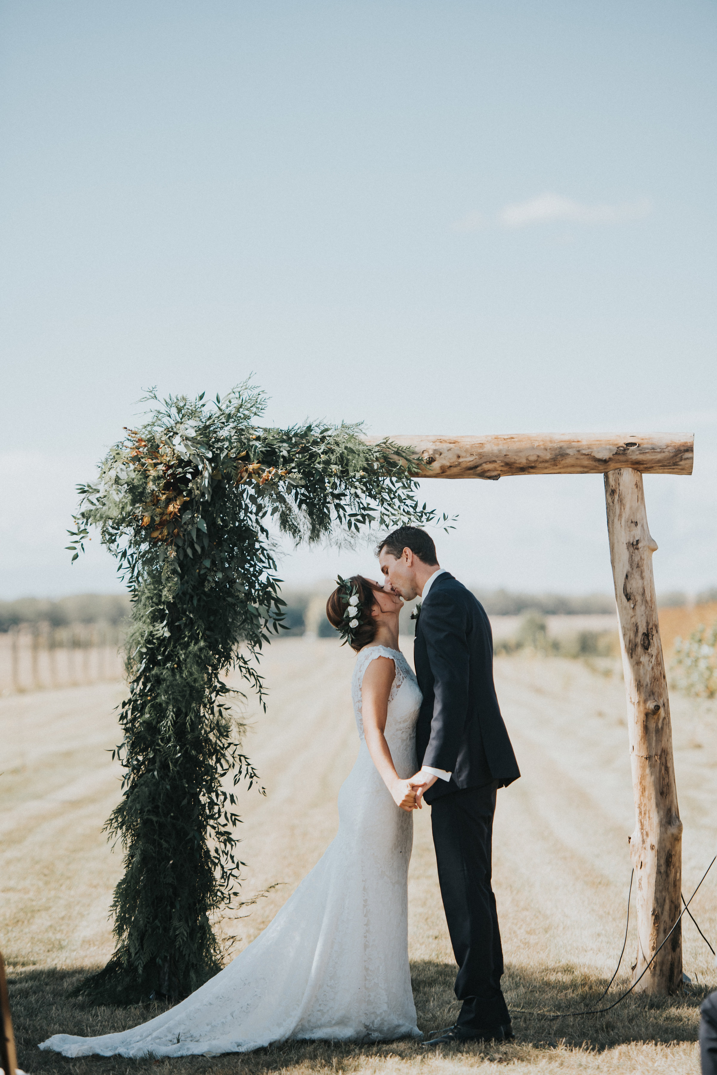 wedding arch or alter with rustic flowers in calgary alberta