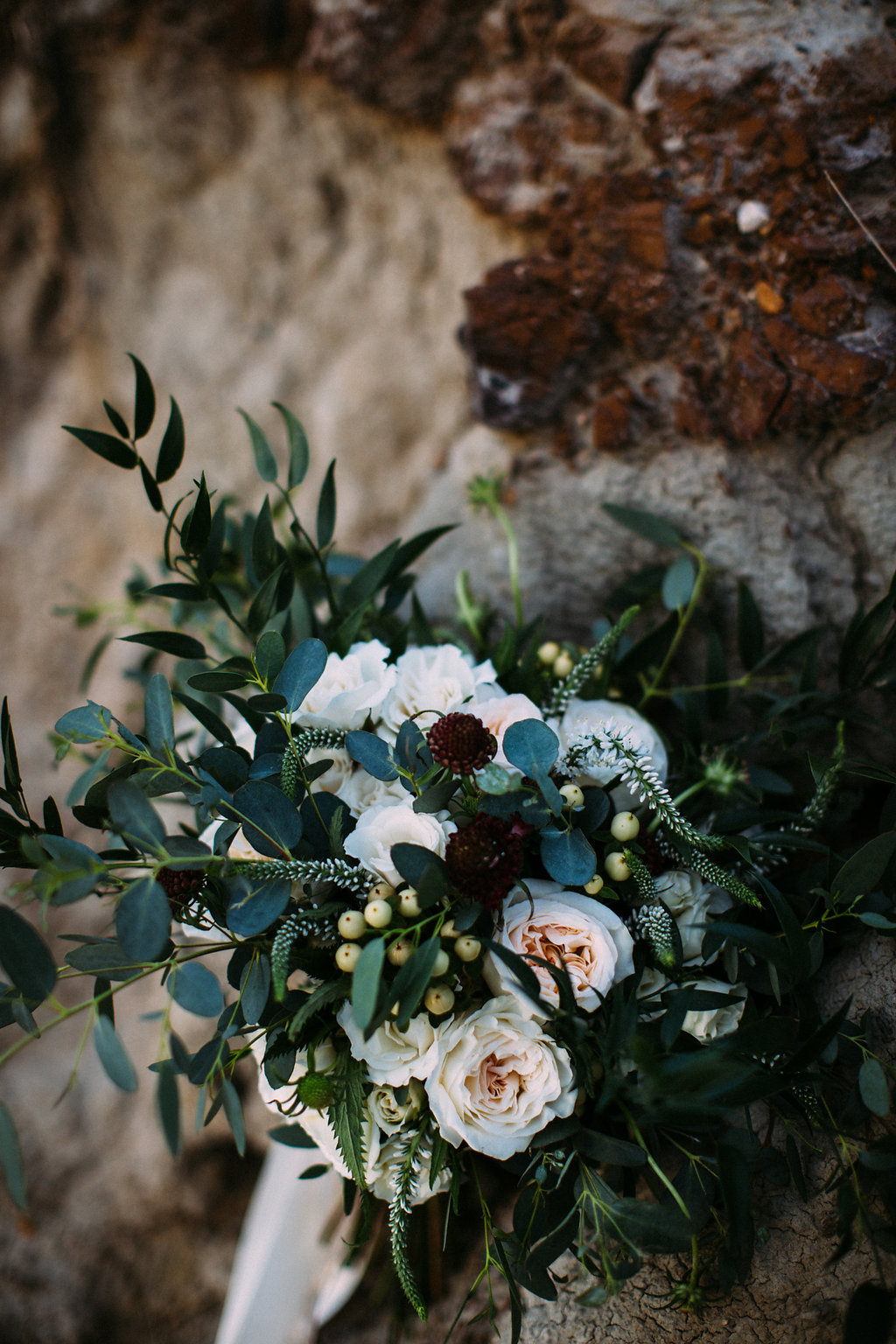 wedding florist based in calgary, alberta making rustic wedding flower arrangements