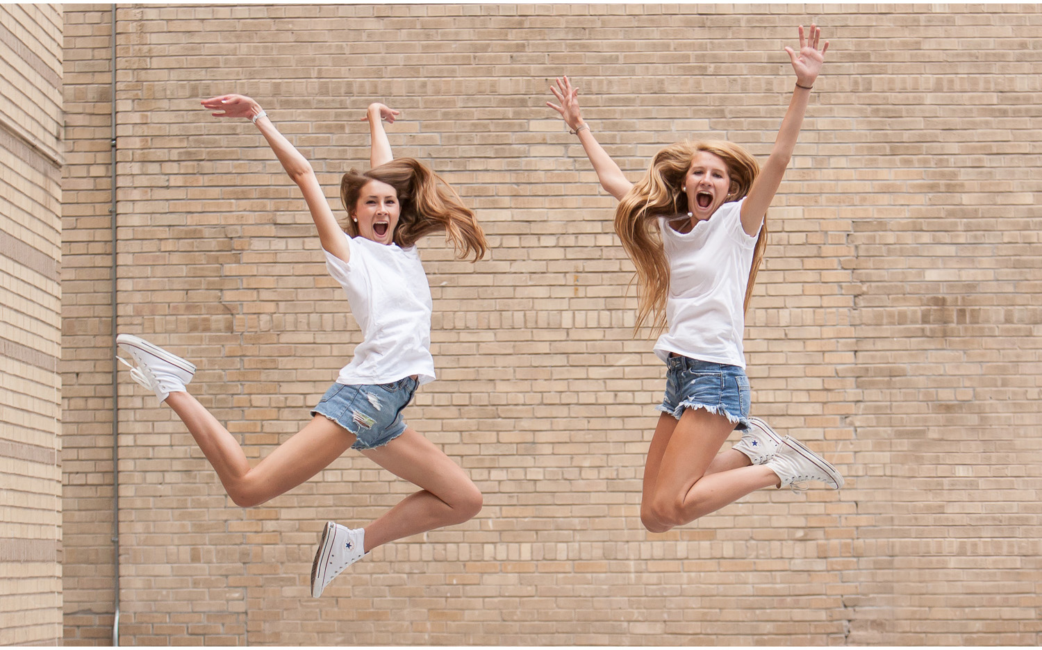 Downtown Denver, jumping best friends senior portrait session with photographer Jennifer Koskinen, Merritt Portrait Studio.