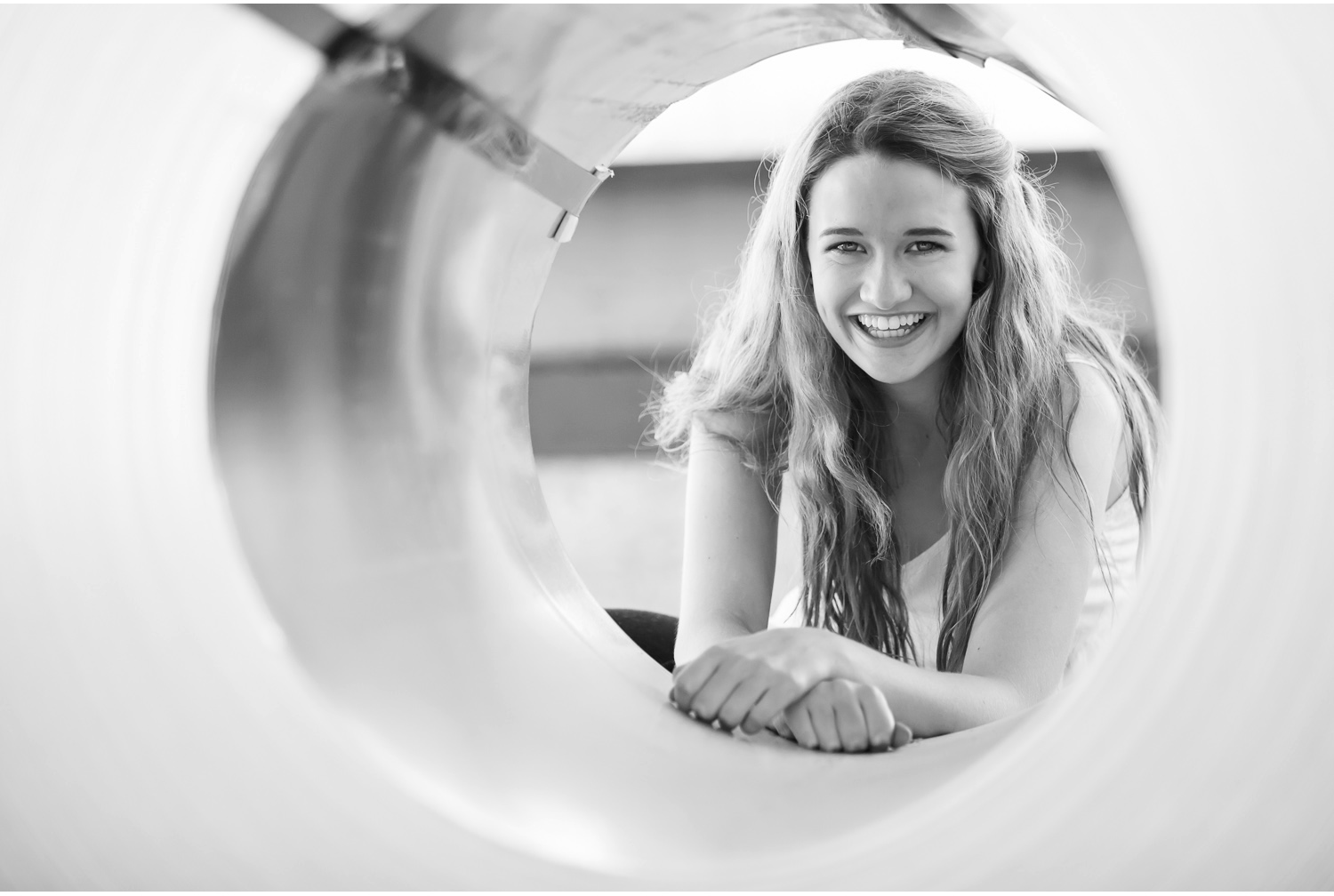 high school senior pictures, peeking through roll of sheet metal in denver | photographer jennifer koskinen | merritt portrait studio