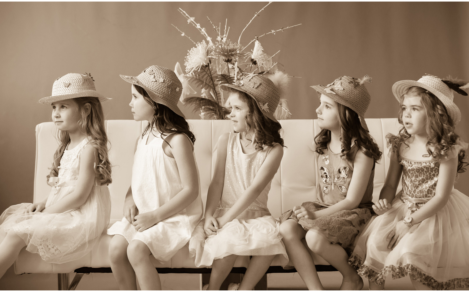 Sepia toned picture from Girls' Portrait Party in Denver with photographer Jennifer Koskinen, Merritt Portrait Studio