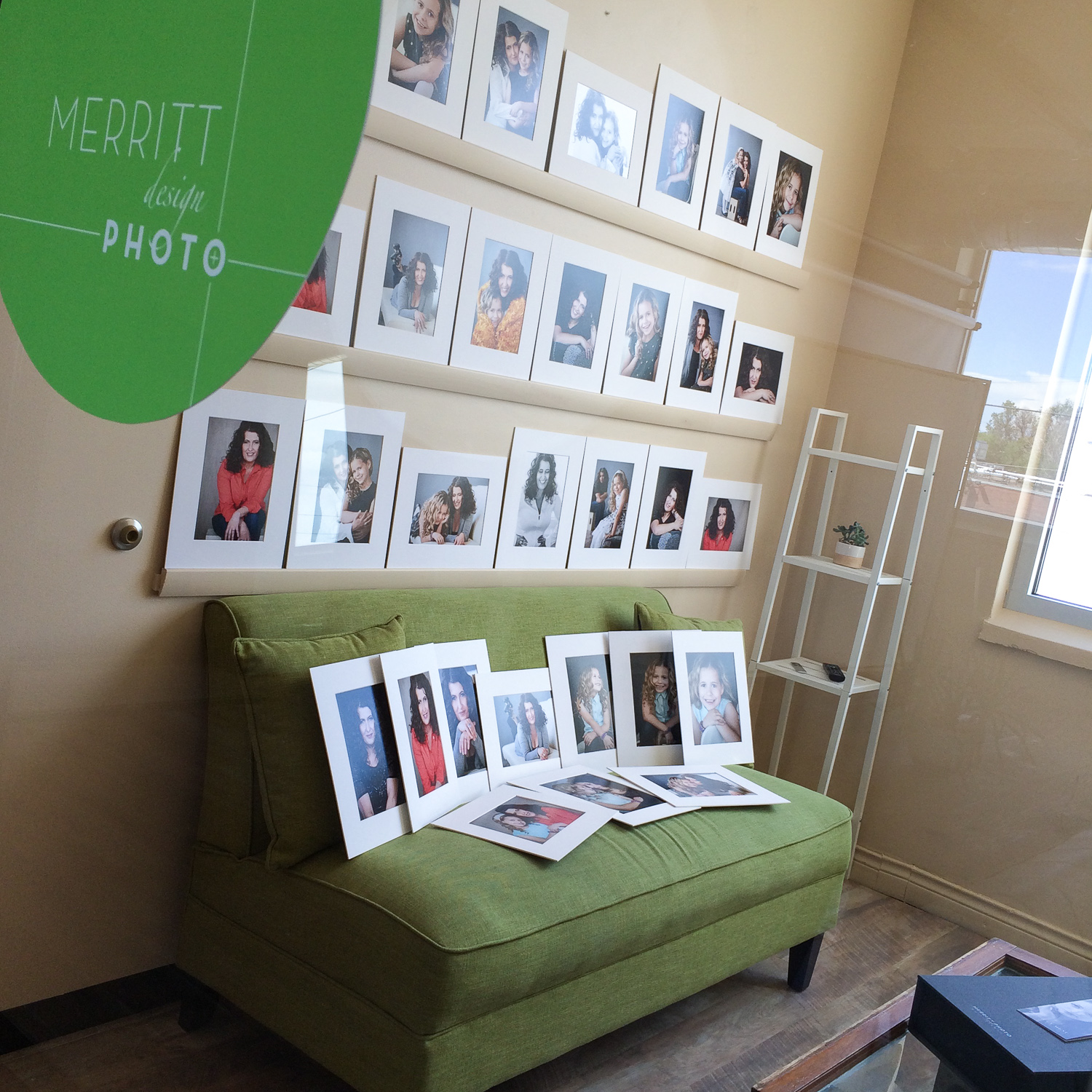 Matted prints on reveal wall during in person sales session at Merritt Portrait Studio in Denver.