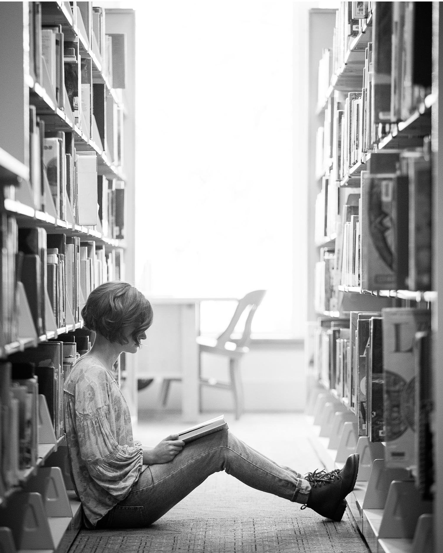 Black and White High School Senior Picture inside Denver Public Library, with photographer Jennifer Koskinen of Merritt Portrait Studio