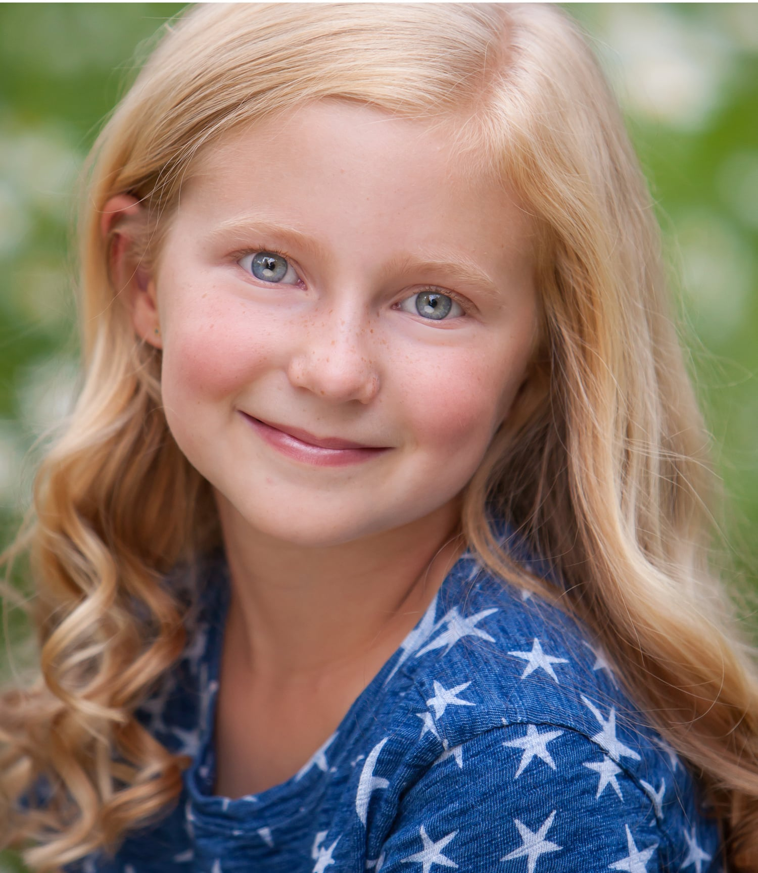 Child Actor headshot of young girl in Aspen Colorado, by photographer Jennifer Koskinen | Merritt Portrait Studio