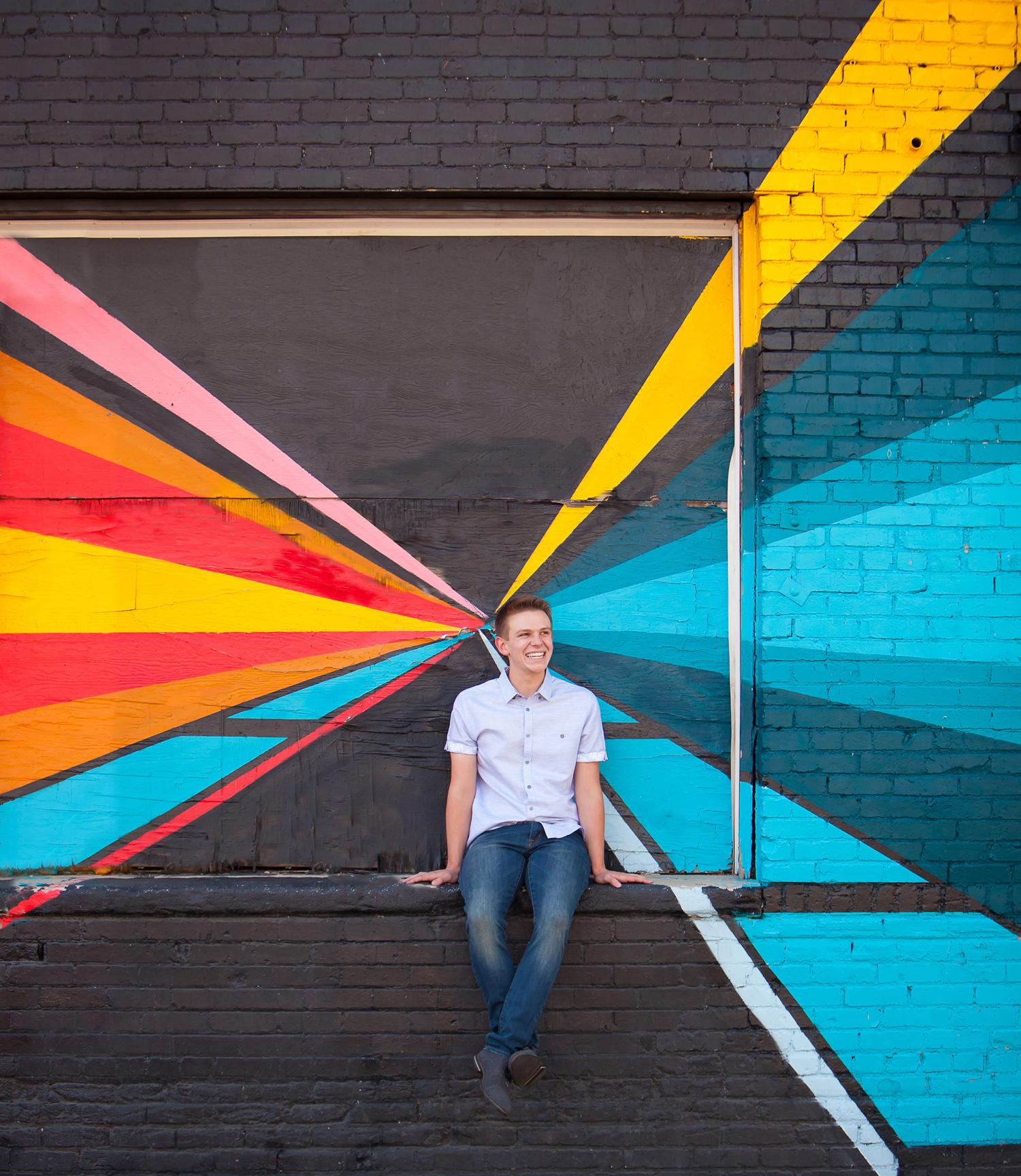 RiNo guy Senior Pictures with graffiti, photographer Jennifer Koskinen of Merritt Portrait Studio