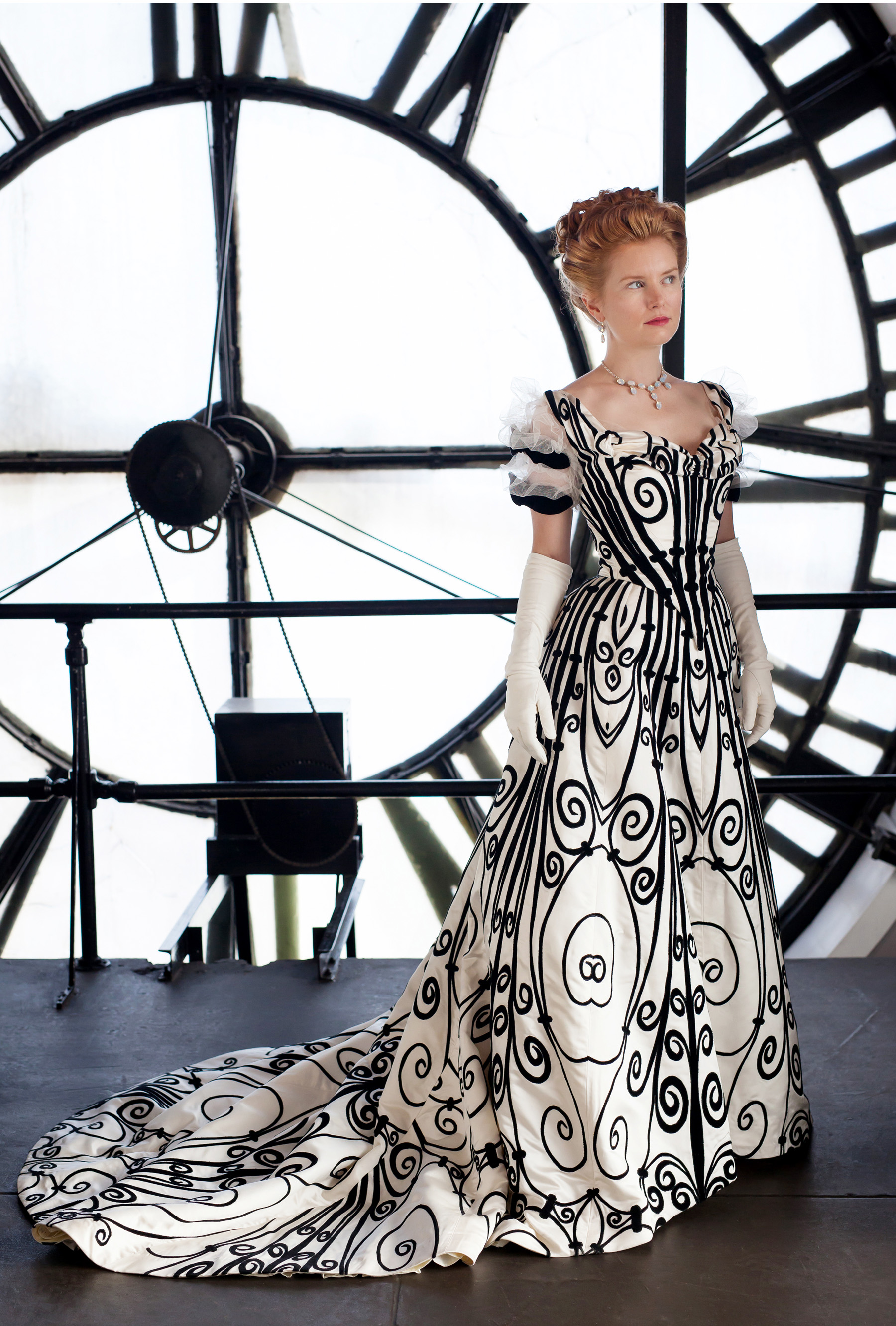 Cynthia Settje of Redthreaded models her Worth Gown photographed in Denver Clocktower by photographer Jennifer Koskinen, Merritt Portrait Studio